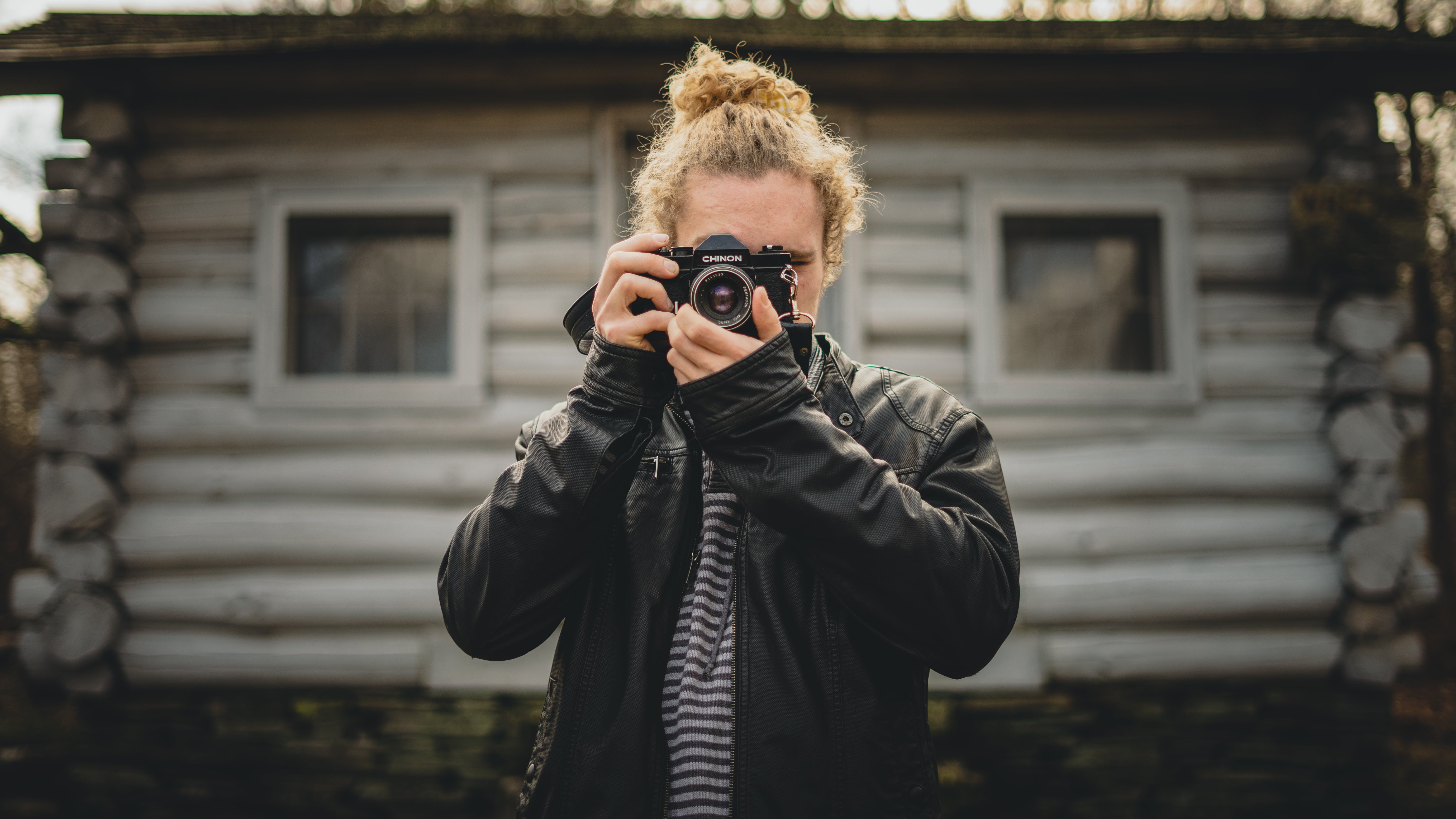 Person Holding Camera