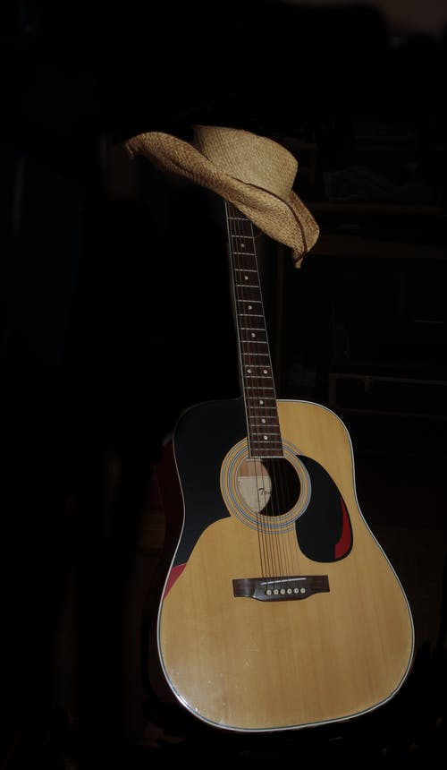 Brown Hat on Acoustic Guitar