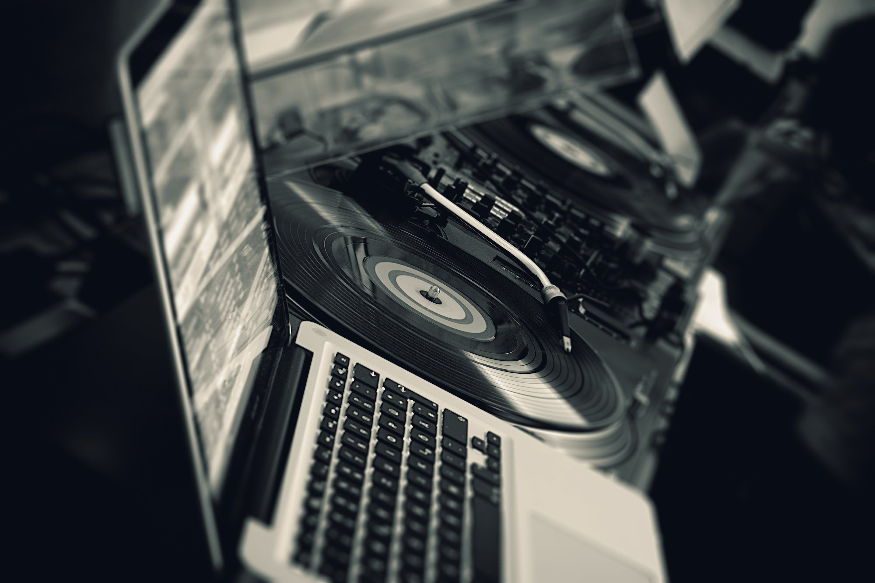 Black Turntable Beside White Laptop Computer
