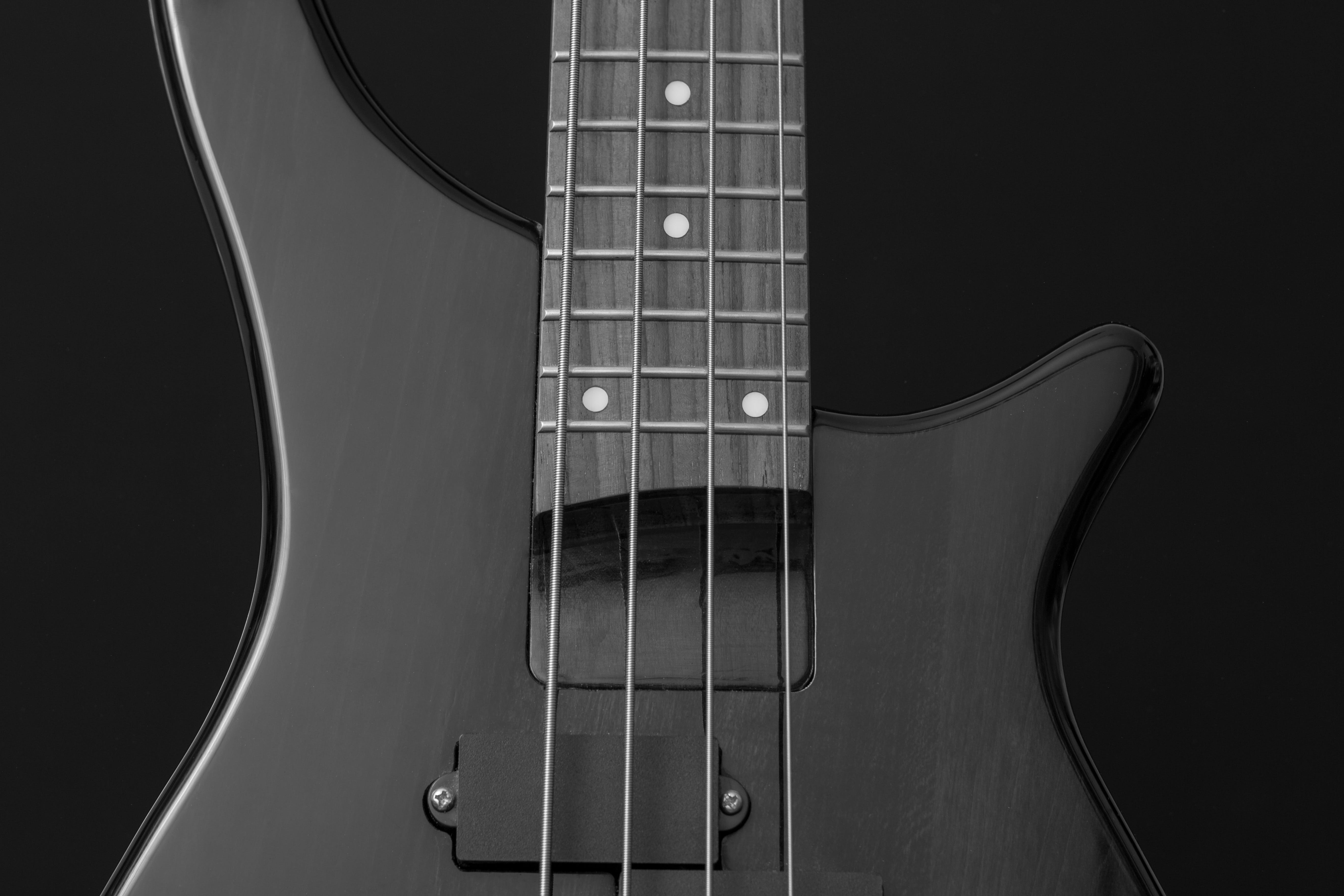 Close Up Photo of Gray Electric Bass Guitar