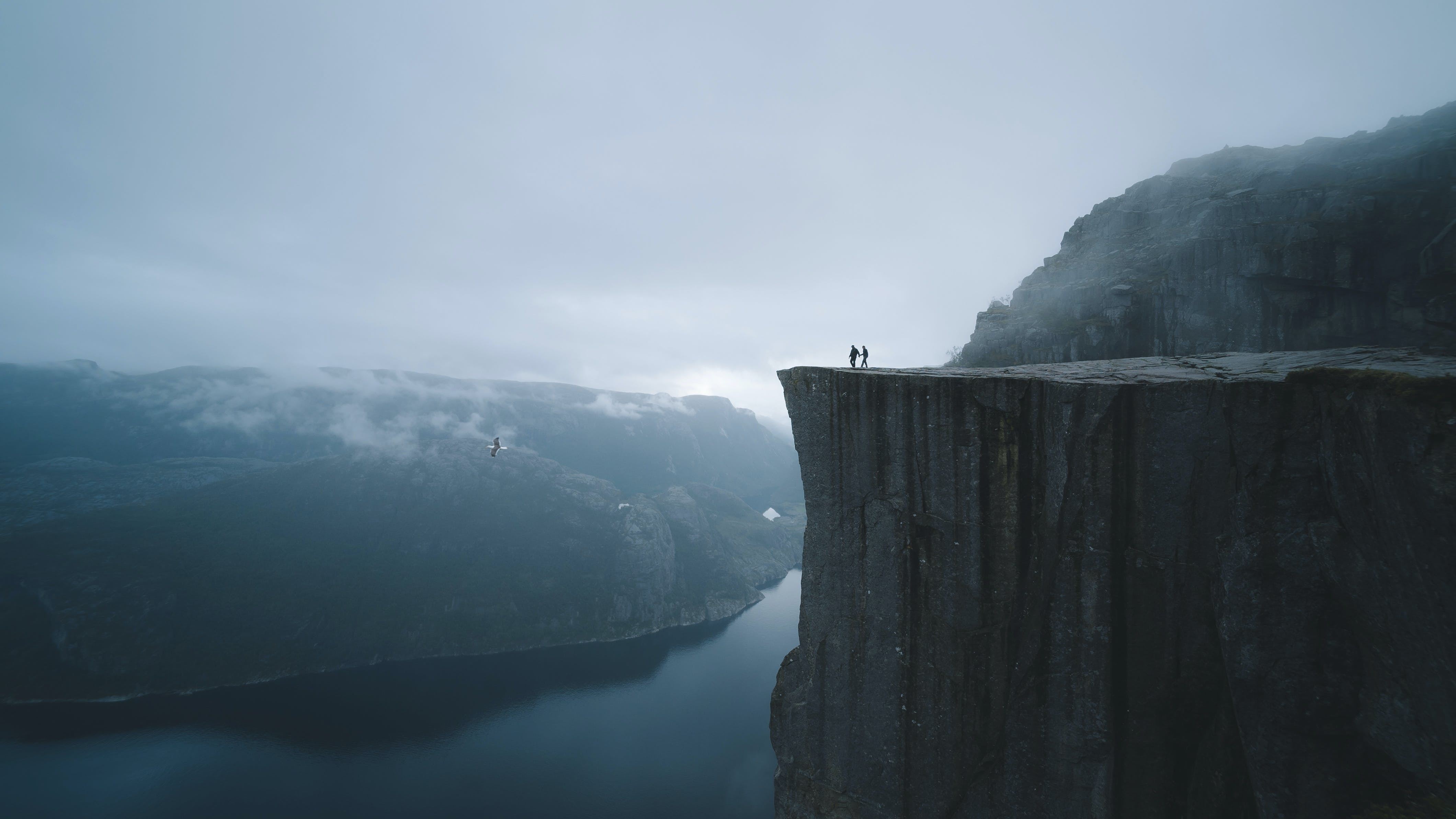 Two People On Mountain Cliff