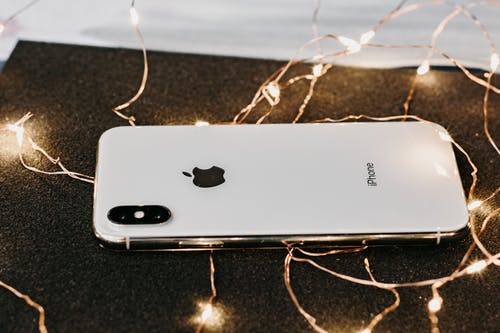 Close-Up Photo Of iPhone Near String Lights