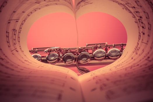 Chrome Musical Instrument Viewed on Heart Shaped Music Score Book