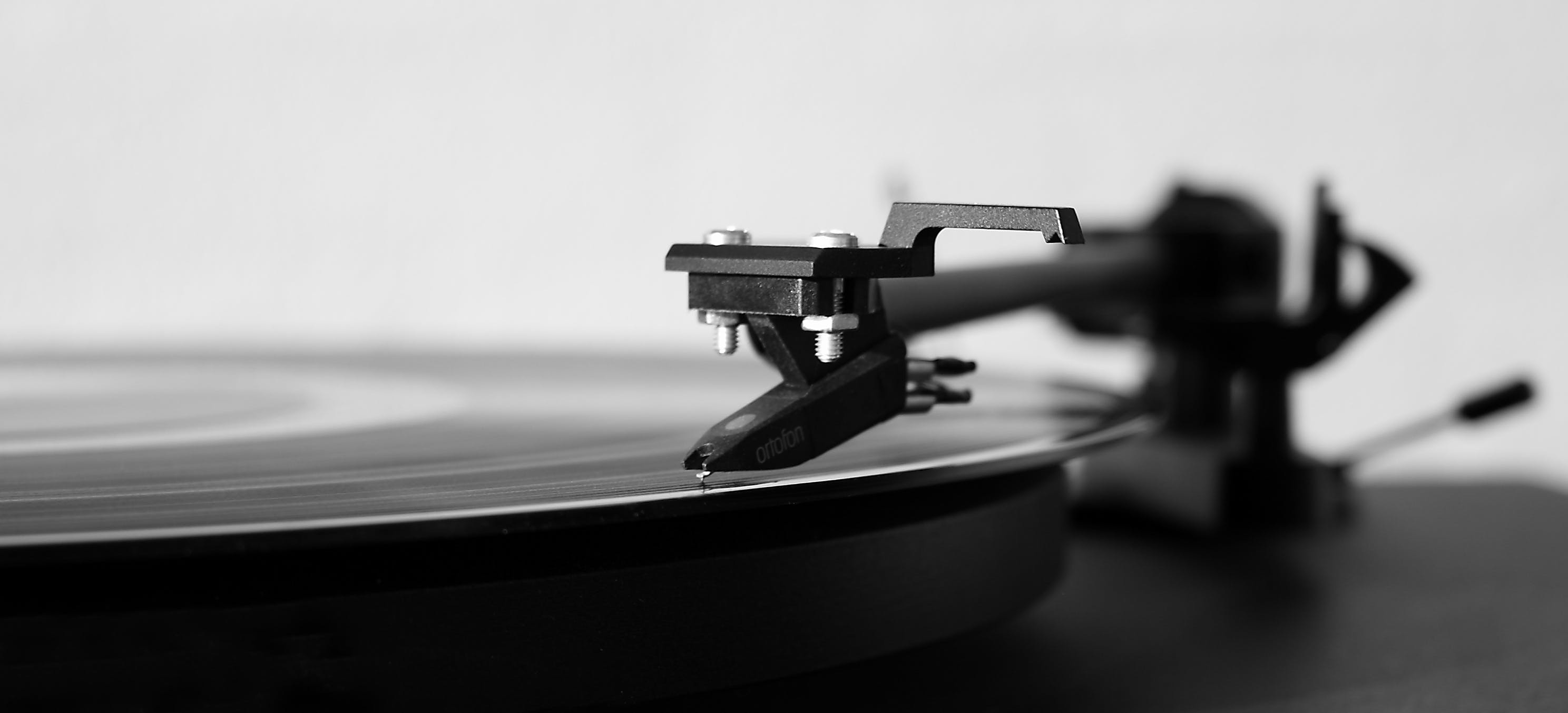 Gray Scale Photography of Turntable