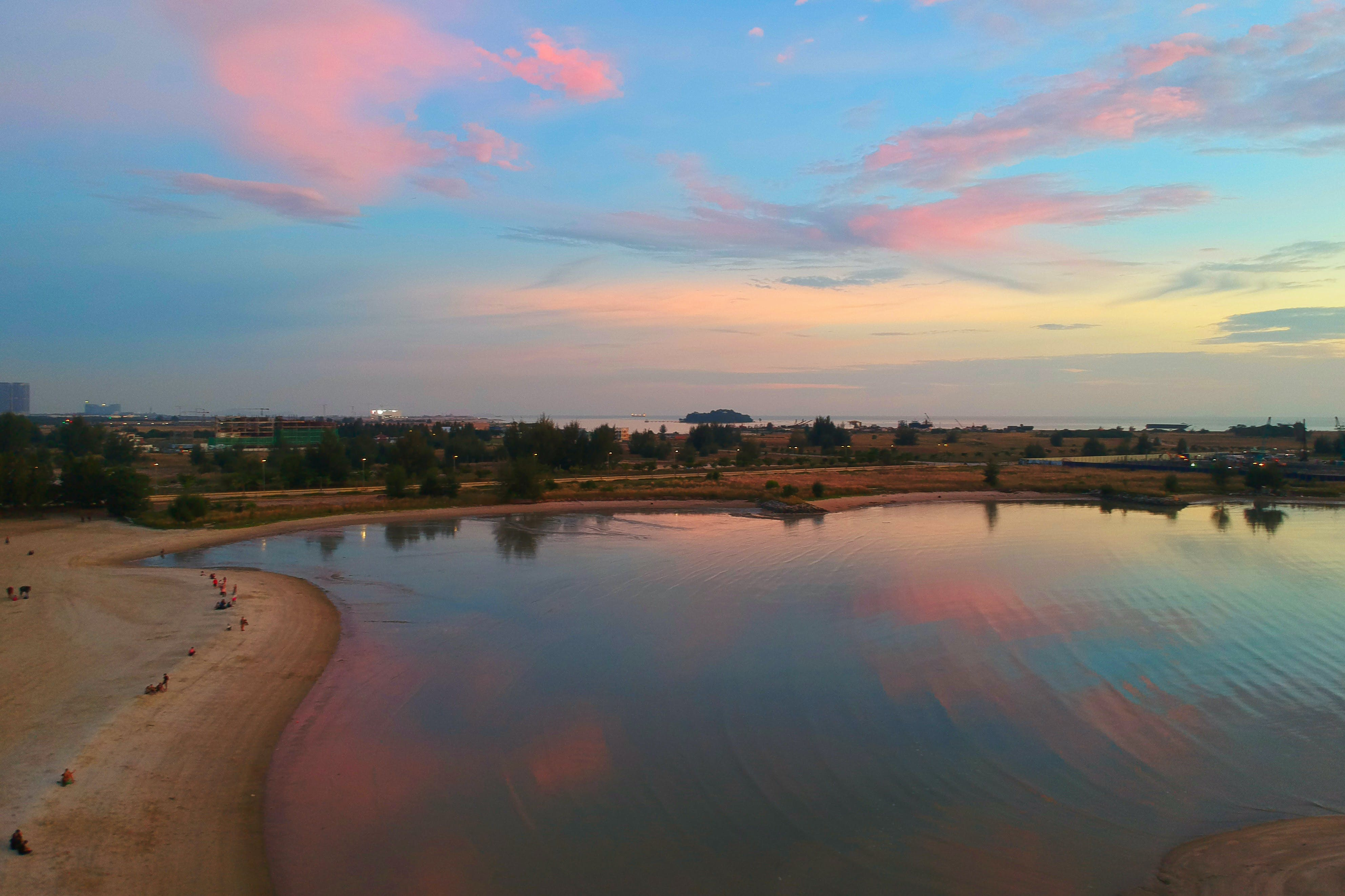 Photo of Body of Water Under Pink Skies