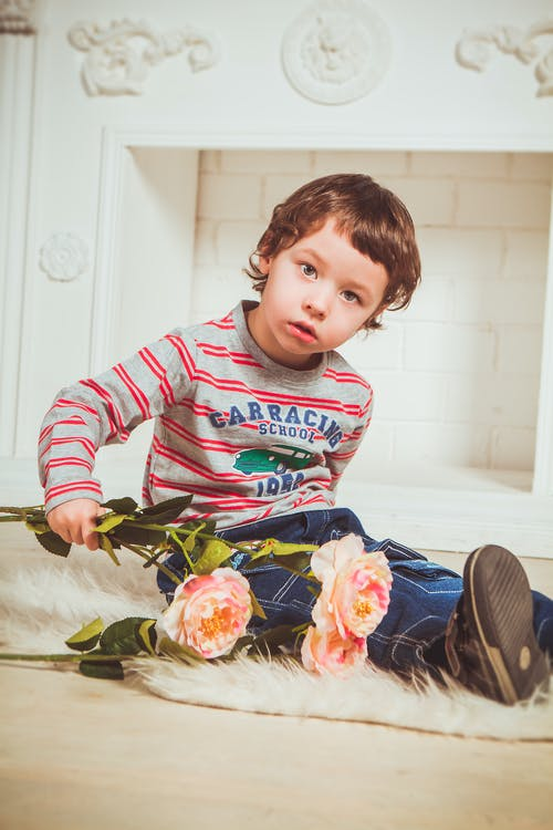 Boy Holding Pink Flowers