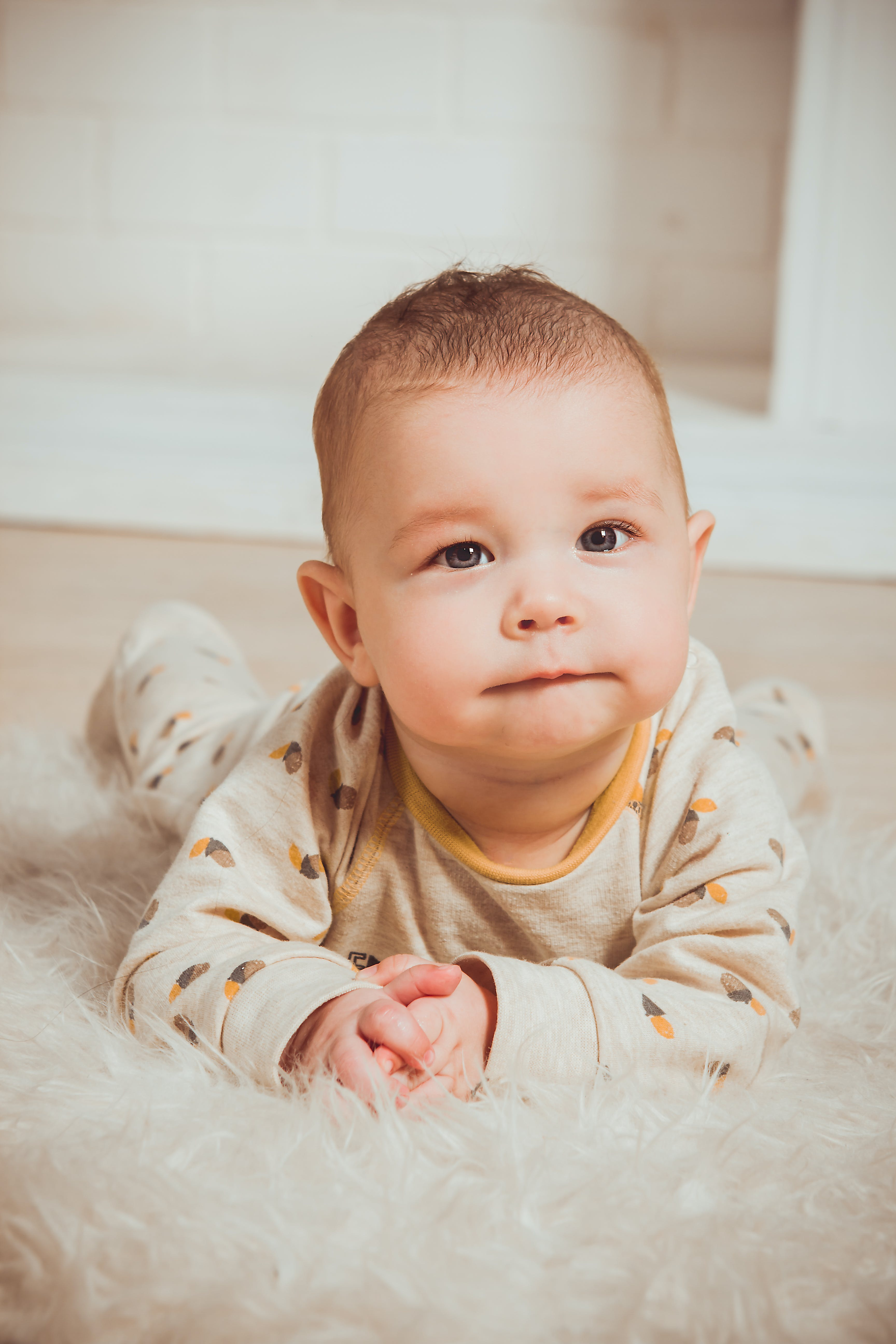 Photograph of a Baby Lying on Tummy