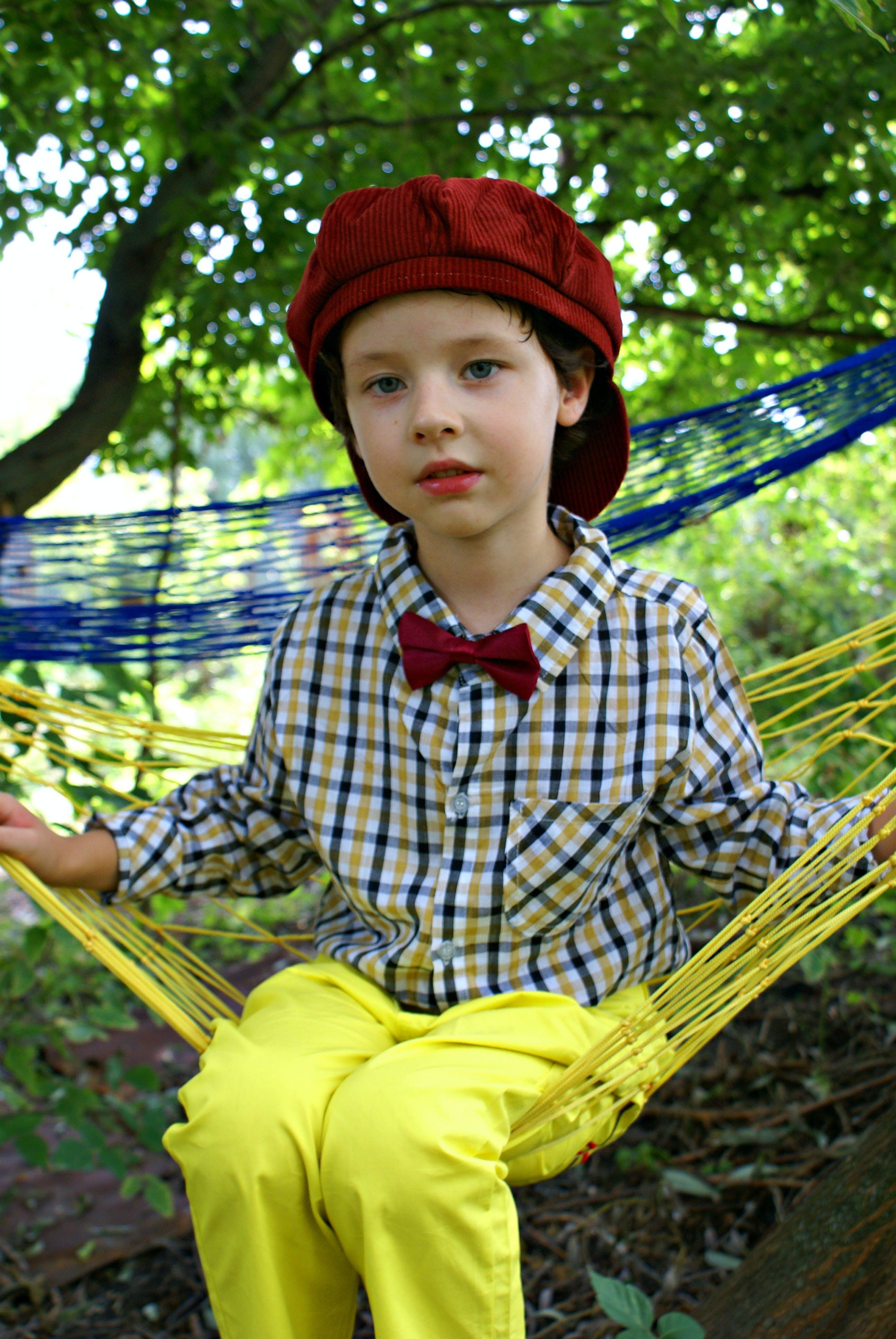 Girl Sitting on Yellow Hammock