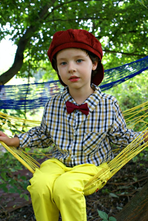 Girl Sitting on Yellow Hammock