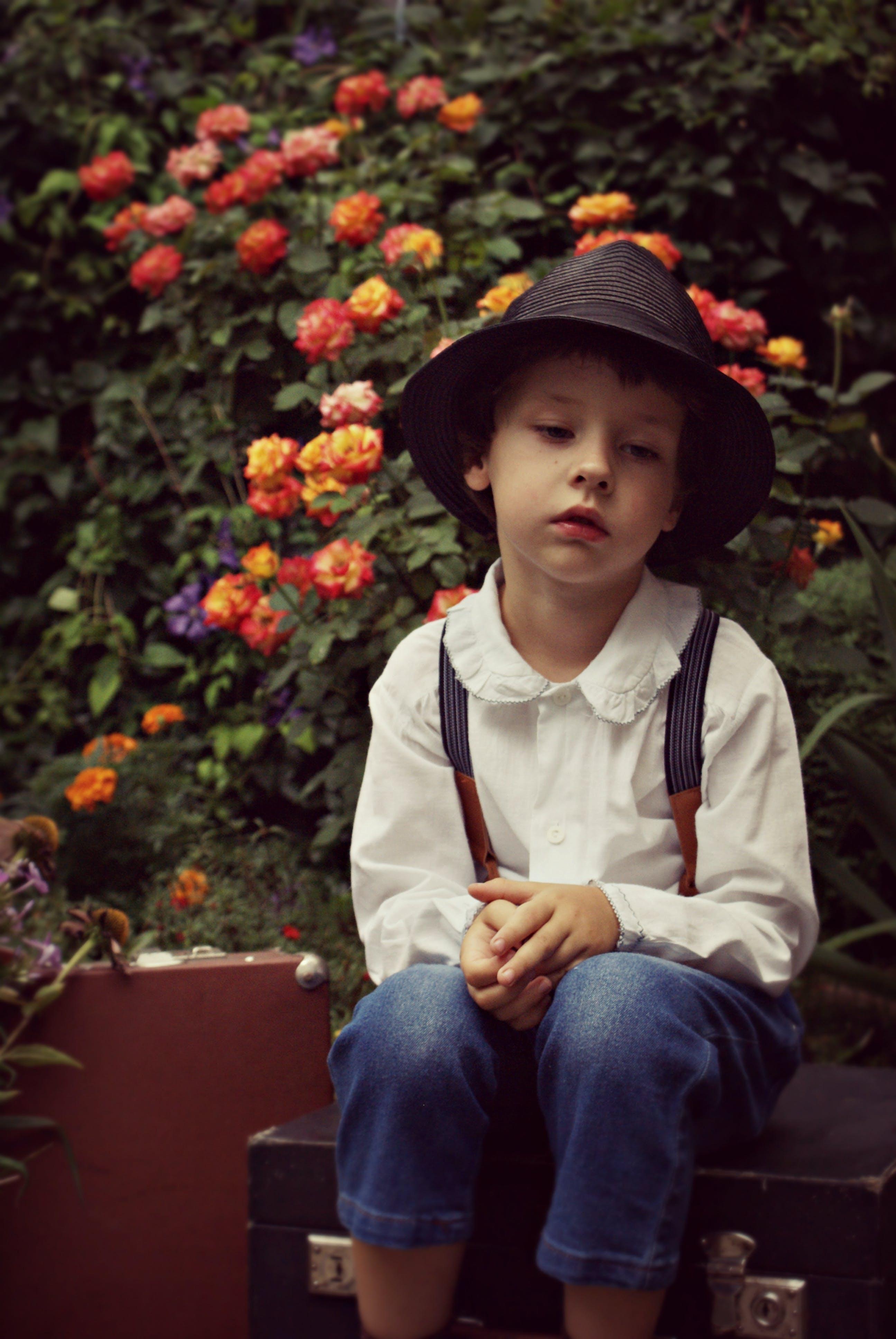 Photo Of Boy Sitting Alone