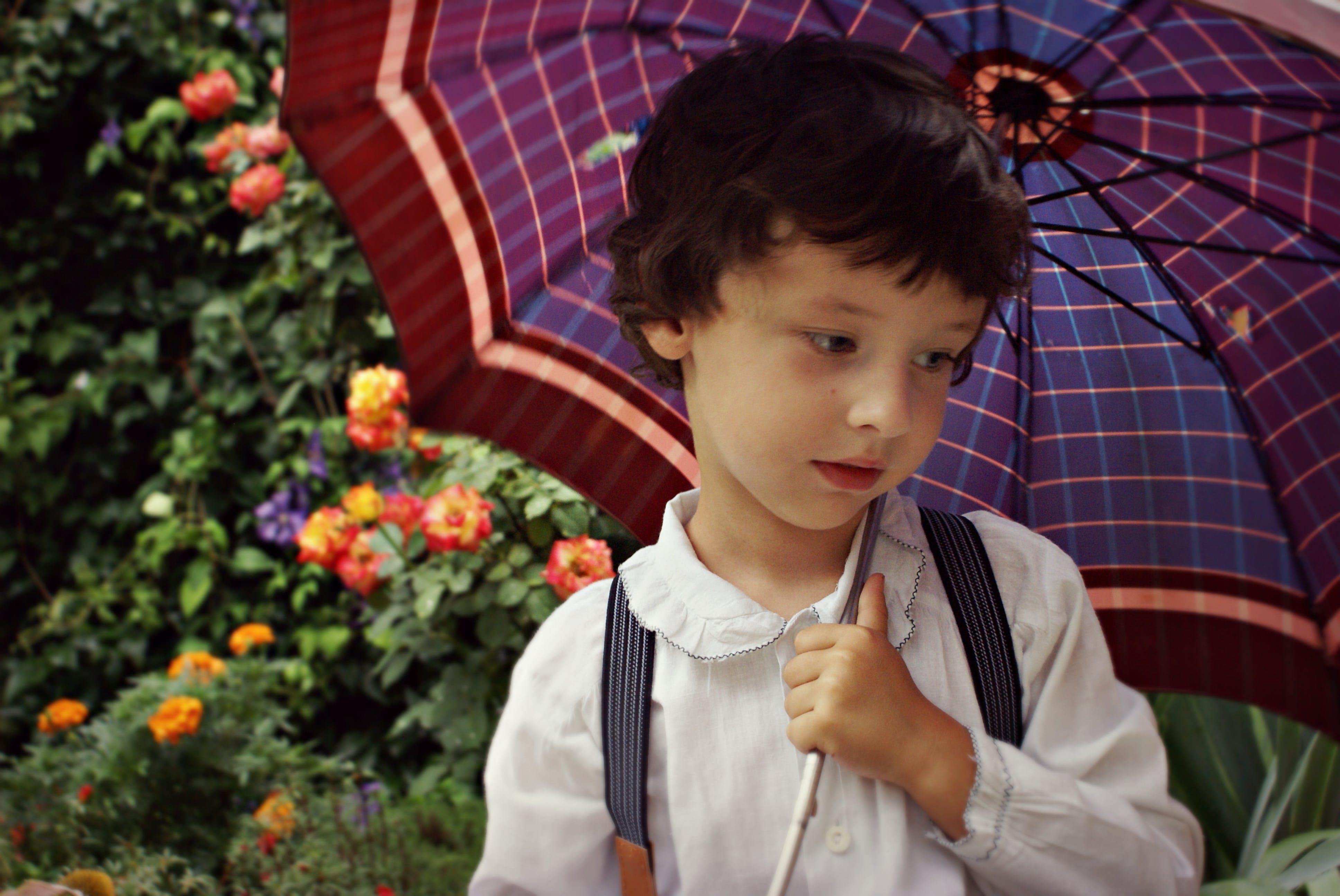 Boy Holding Purple Umbrella