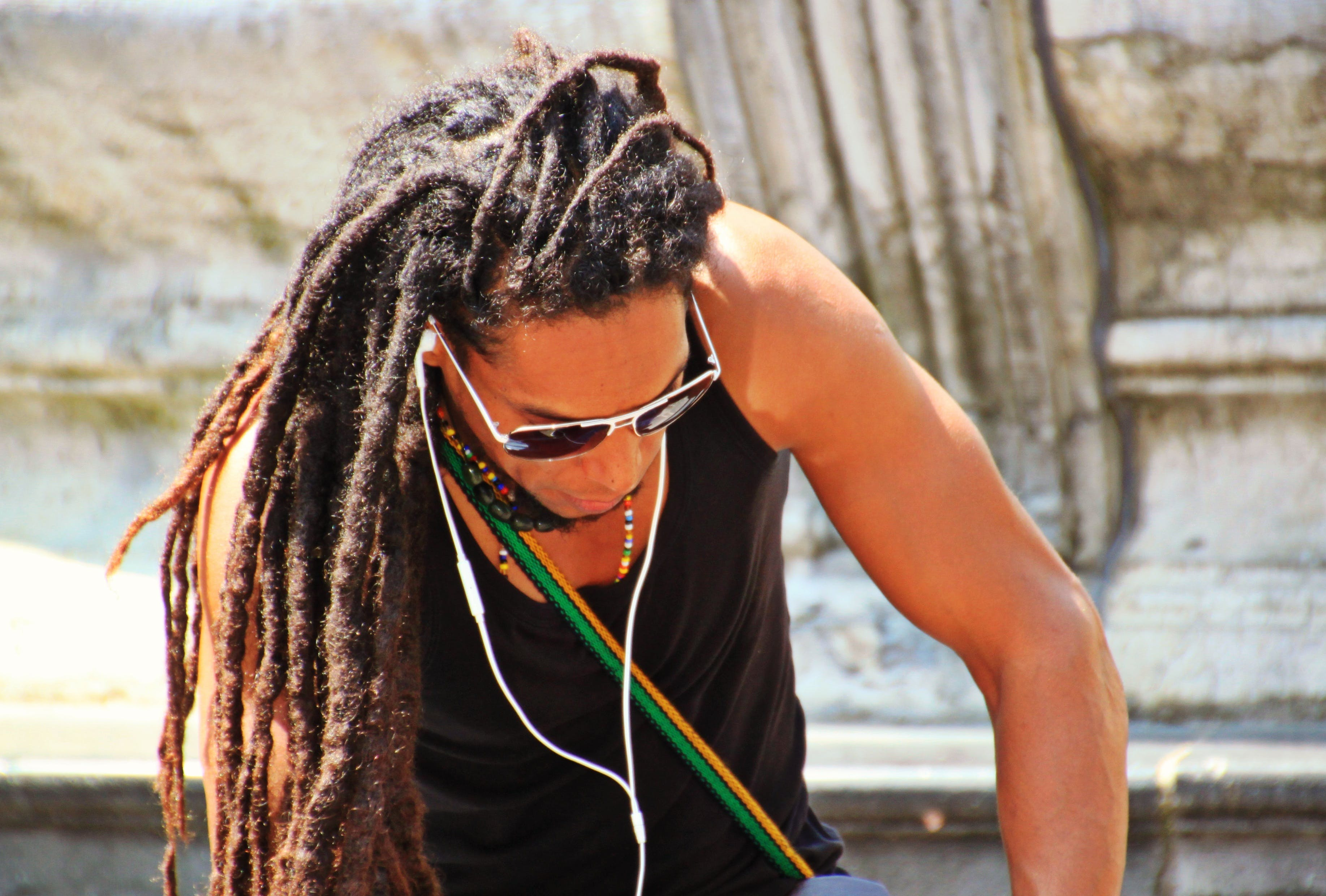 Man in Black Tank Top With Braided Hair