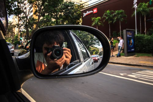 Man Taking Photo Inside the Car