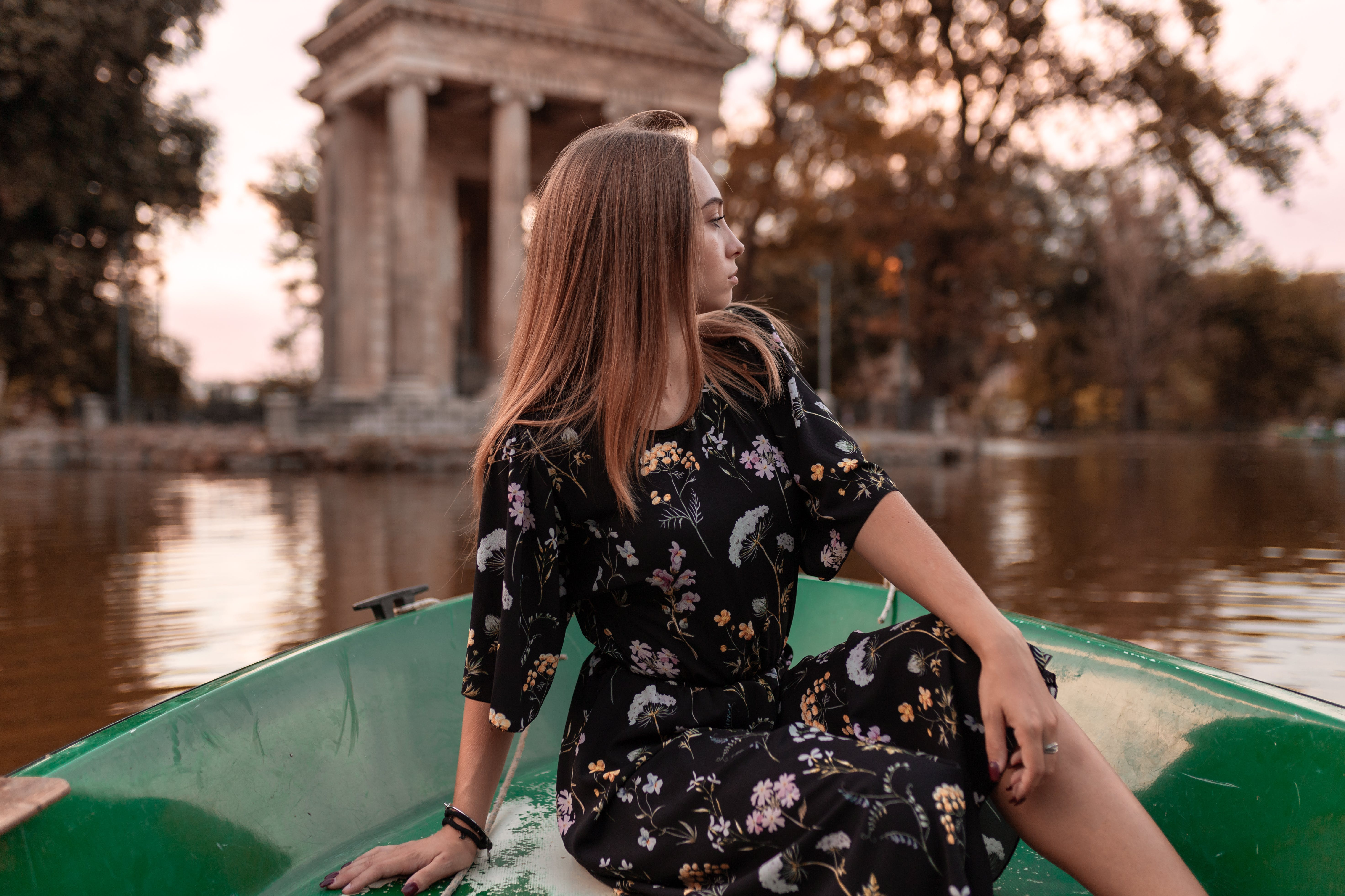 Woman in Black Dress Riding Boat