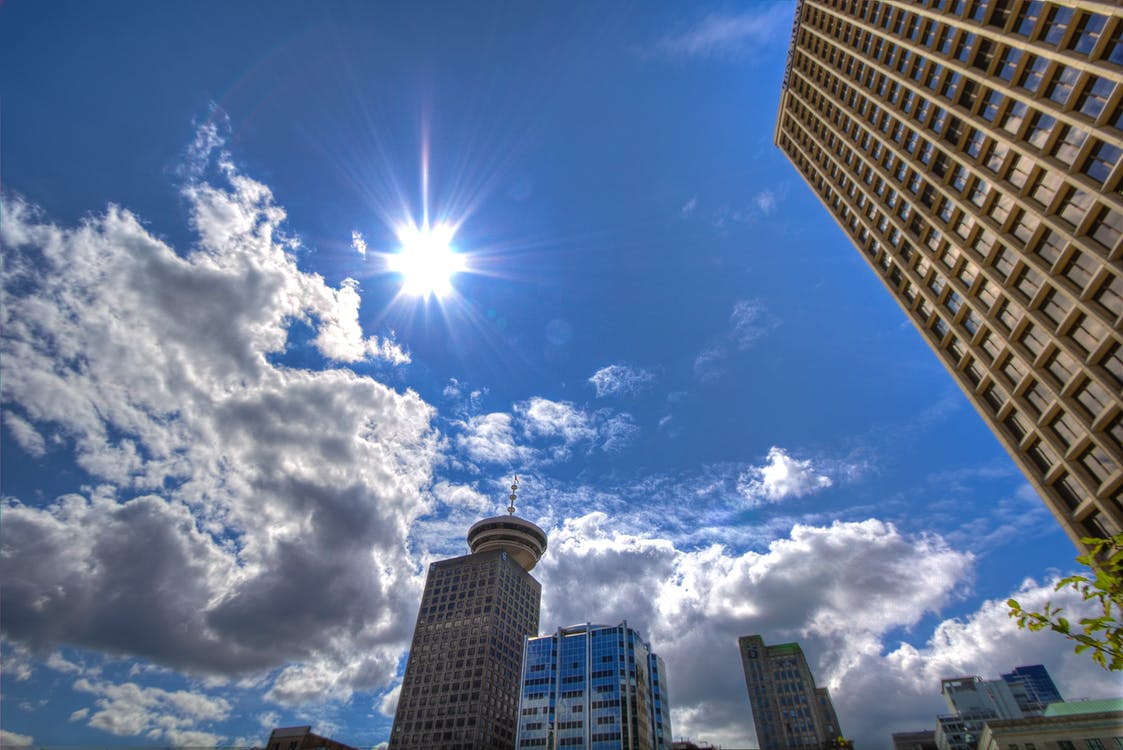 Low Angle Photography of Skyscrapers Under White and Gray Cloudy Blue Sky at Daytime