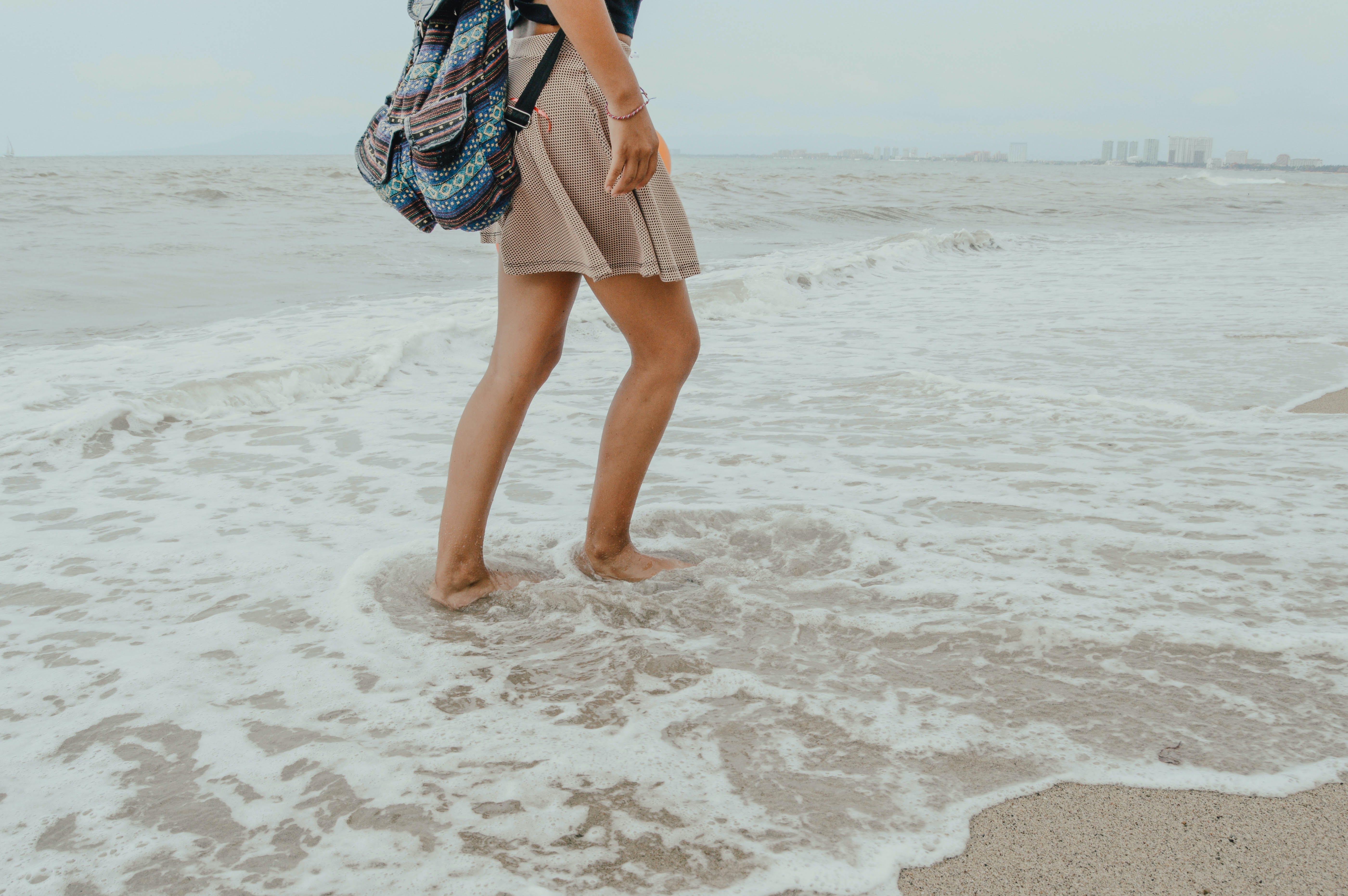 Photo of Person On Seashore