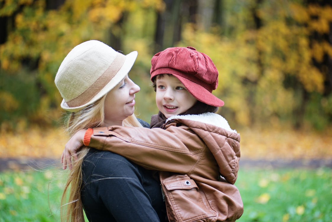 Woman Carrying Girl on Outdoors