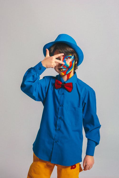 Boy With Face Paint Posing For Photo