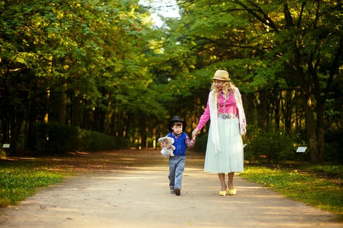 Woman Walking With Boy