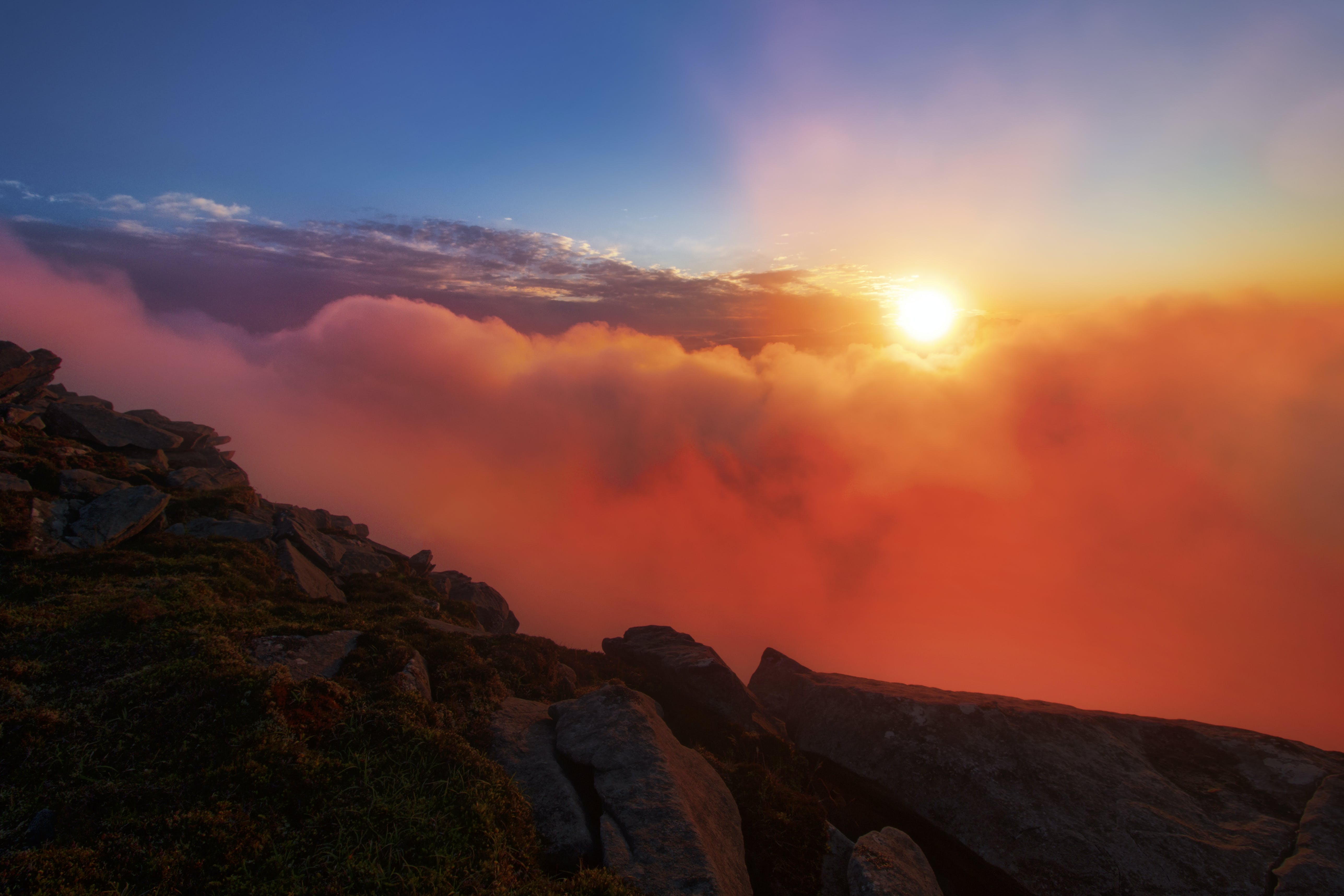 Sun Peaking Over Clouds