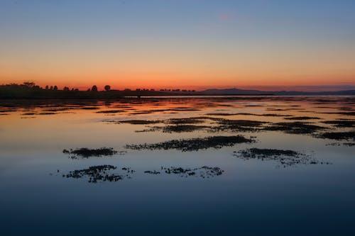 Fotos de stock gratuitas de al aire libre, amanecer, anochecer, condado hacia abajo
