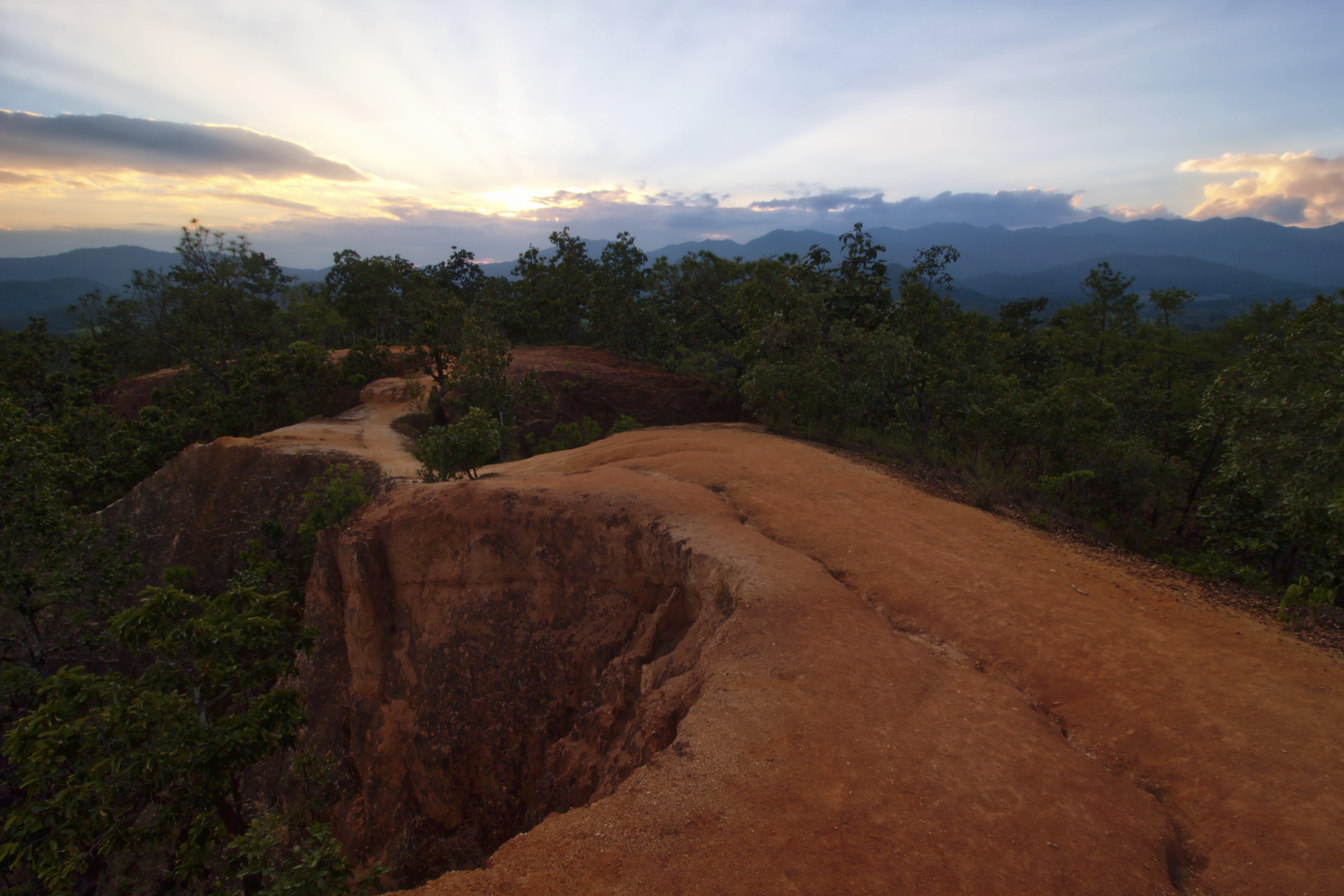Rock Formation Pathway Between Trees Under Crepuscular Wallpaper