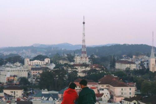 Two People Overlooking The View Of City