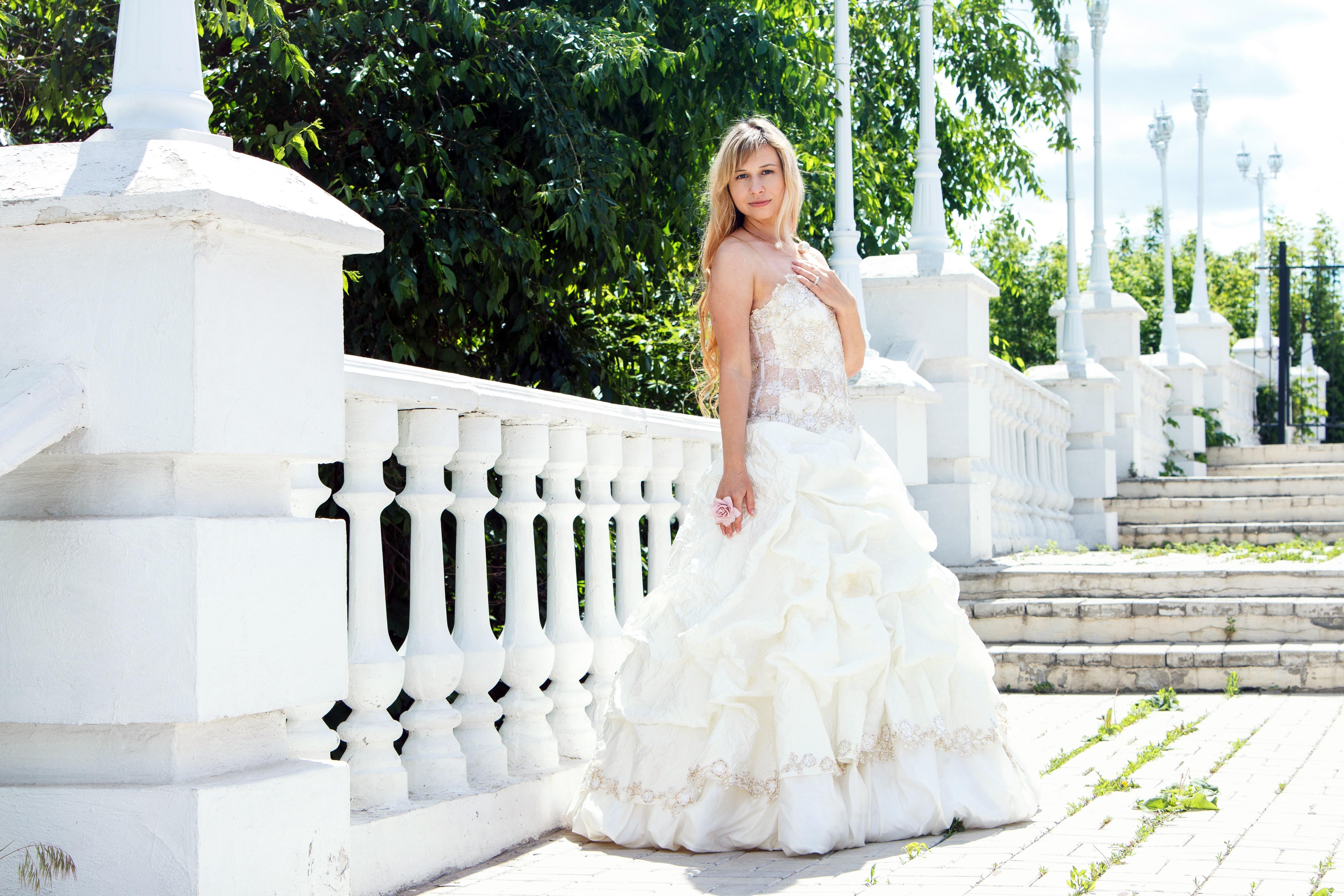 Wearing White To A Wedding.Woman Standing Wearing White Wedding Dress Free Stock Photo