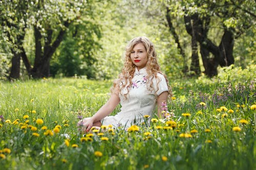 Woman Sitting on Yellow Black-eyed Susan Flower Field