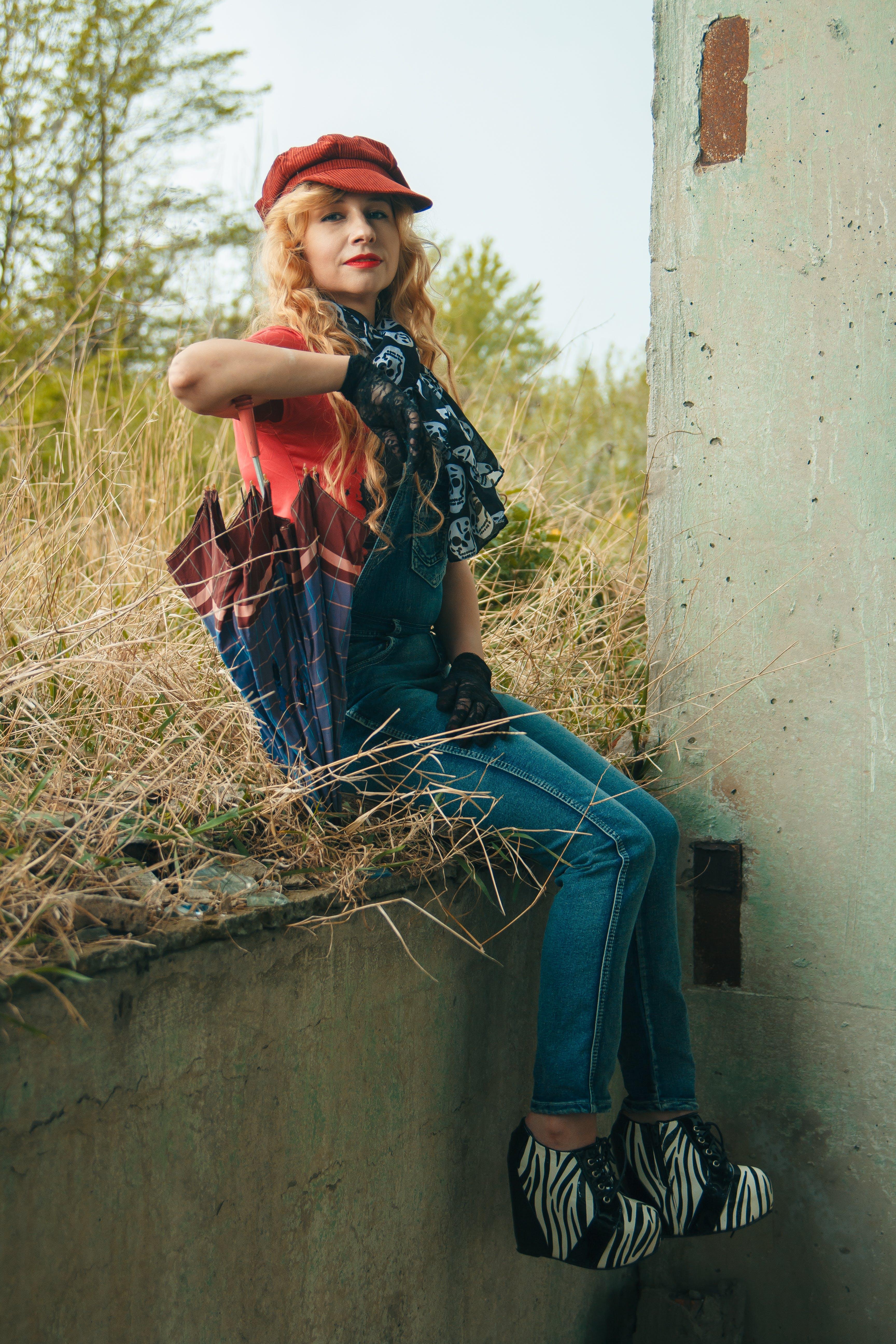 Photo of Woman Wearing Denim Jumper