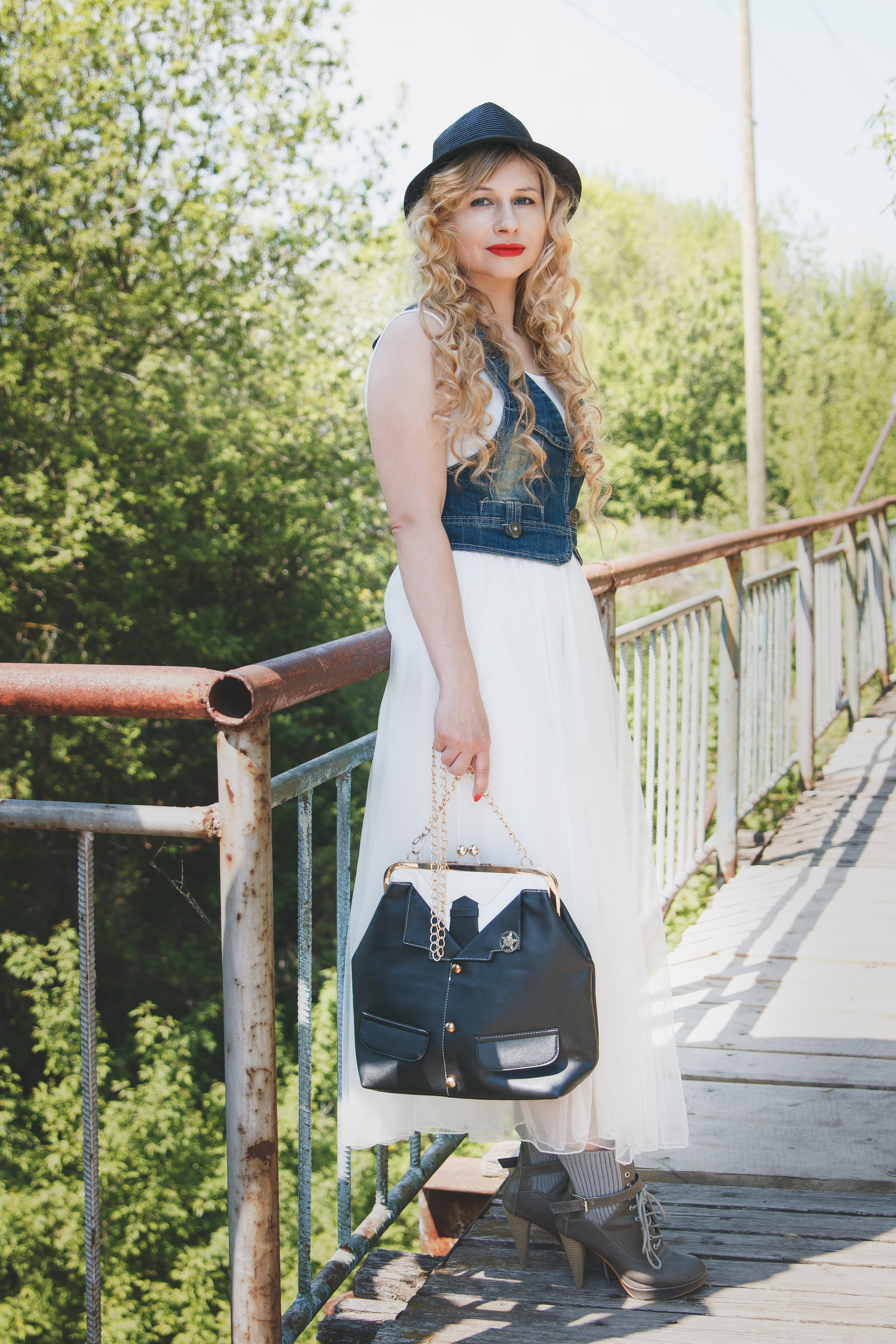 Woman in Denim and White Dress