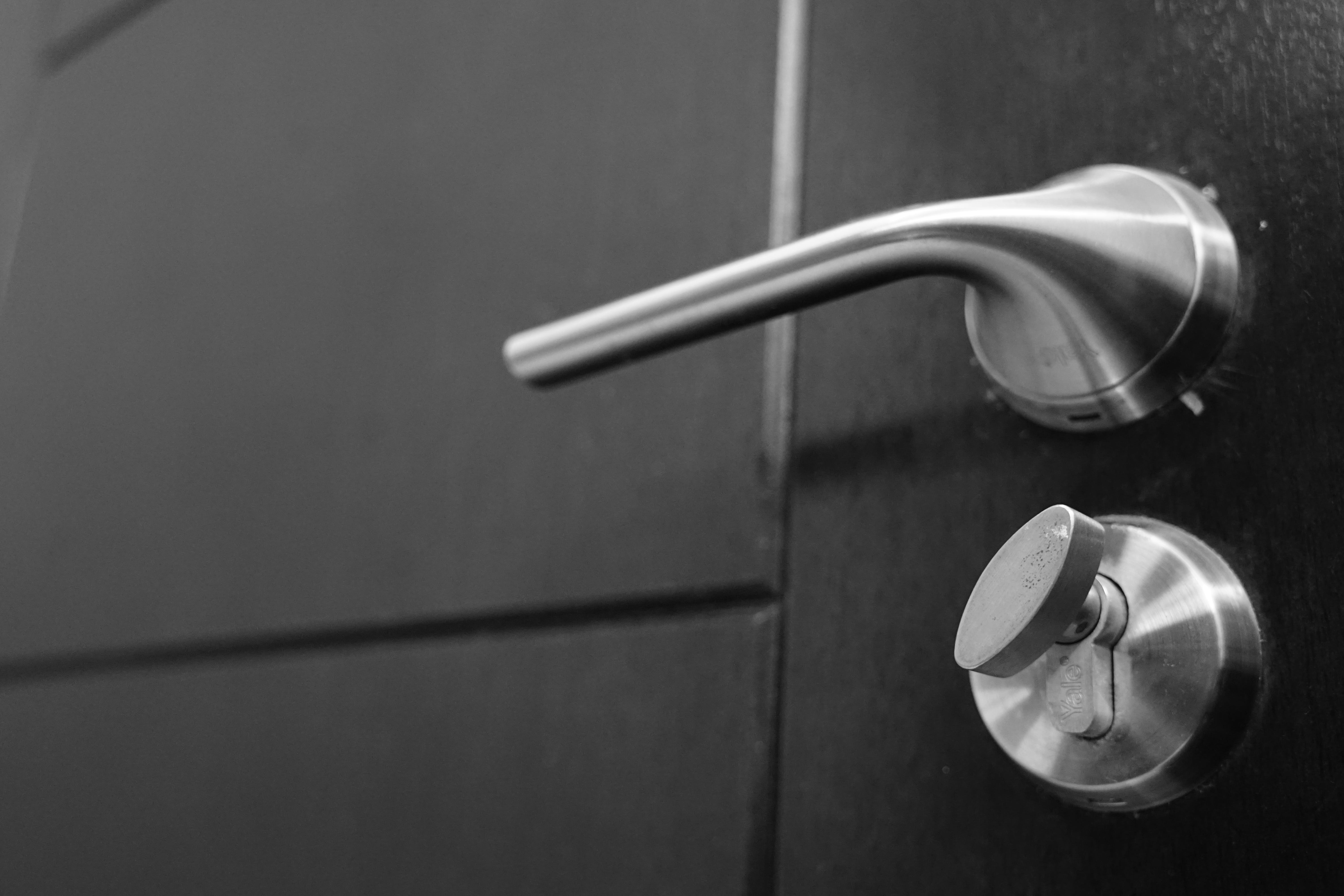 Close-up Photography of Gray Stainless Steel Door Lever and Lock
