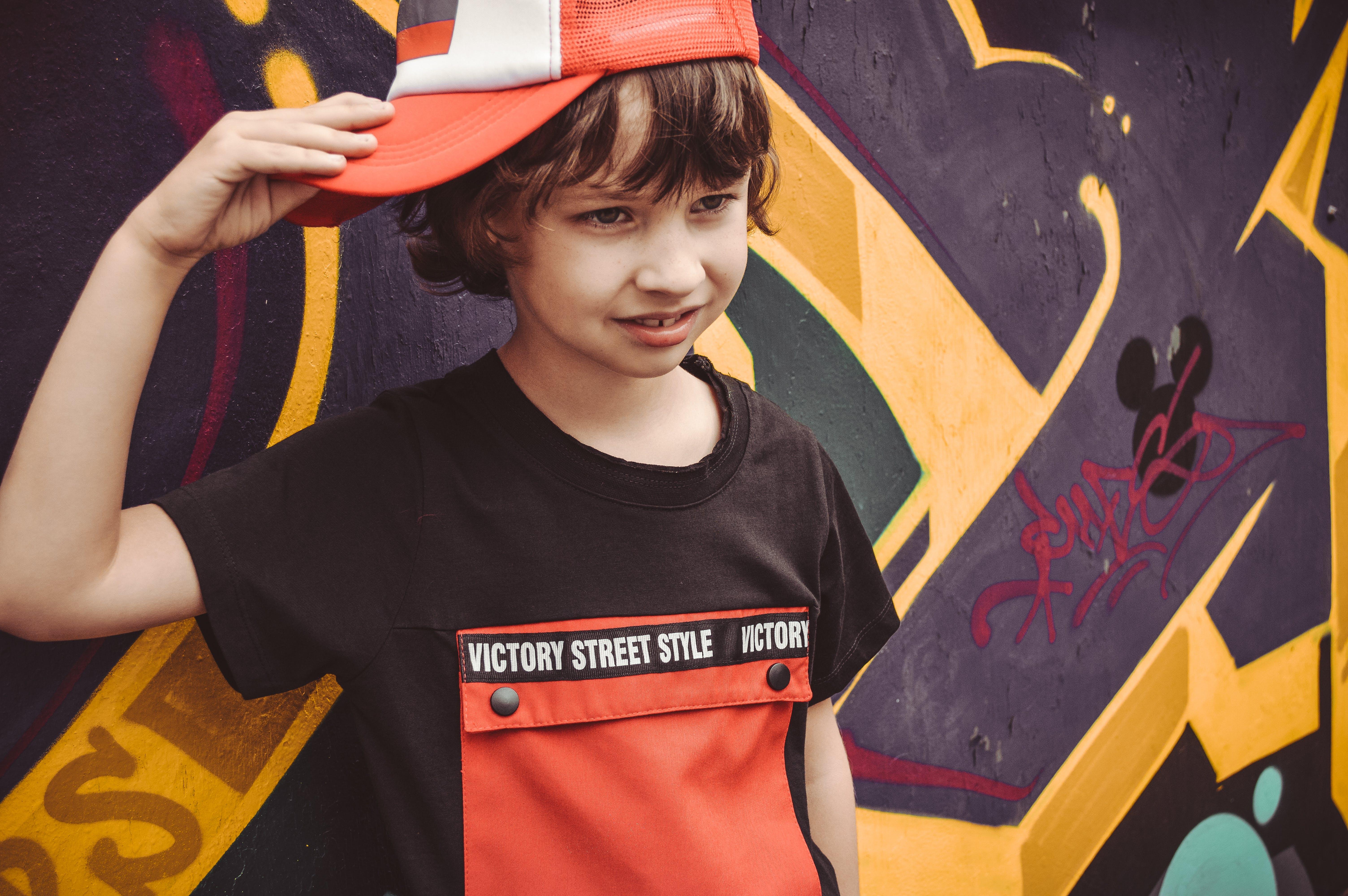 Boy Holding His Hat