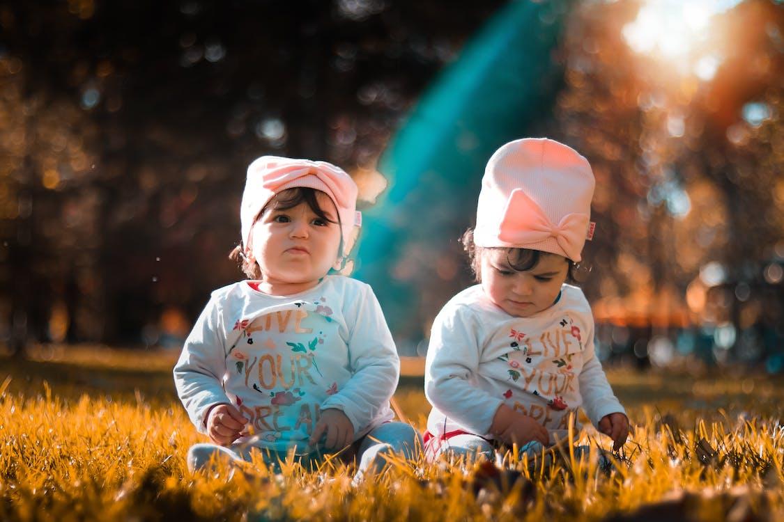 Twins On Grass Field