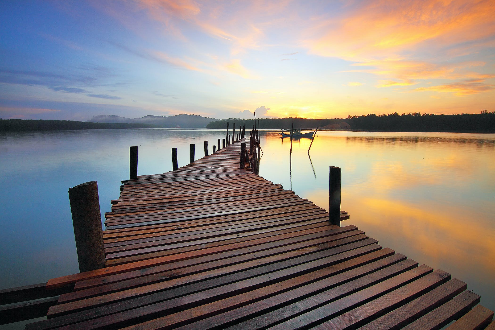 Brown Wooden Dock on Calm Body of Water Surrounded by Silhouette of Trees during Sunset