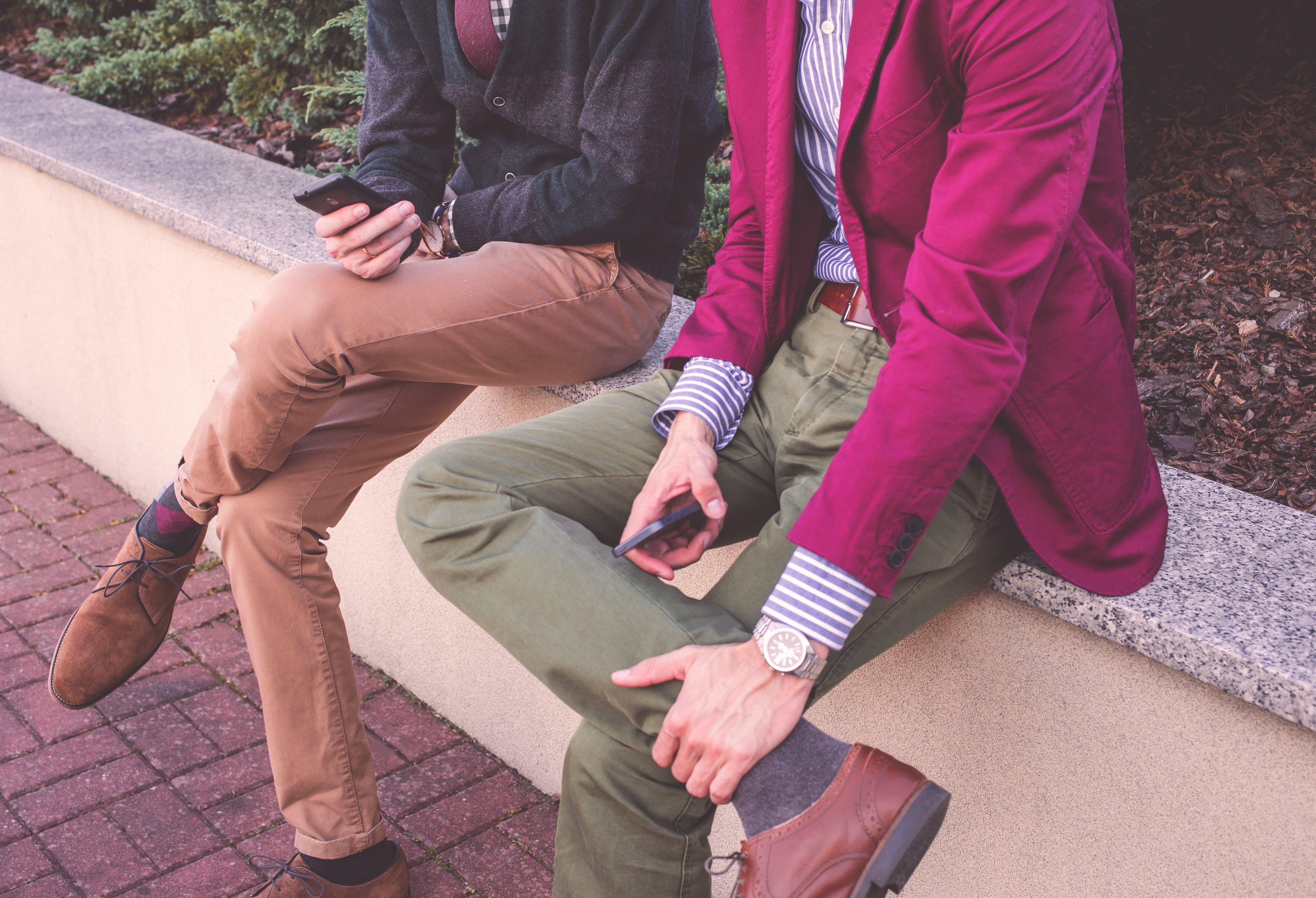 2 Men Wearing Formal Attire Sitting Beside Each Other