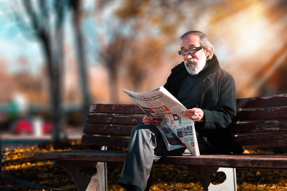 An old man sitting in the park.   Photo: Pexels