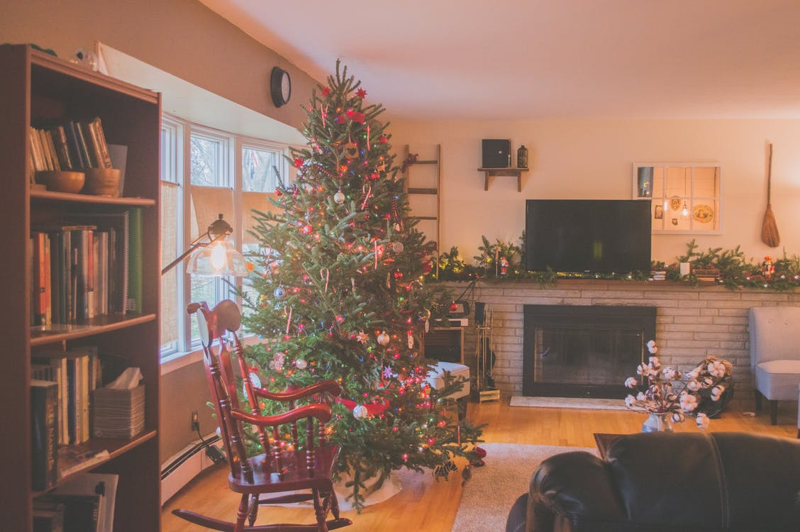Green Christmas Tree Beside Window Inside Room