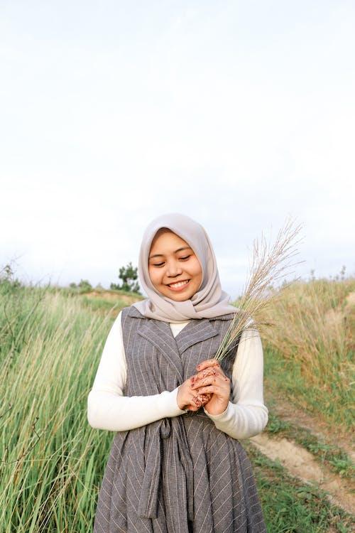 Woman Holding Wheat Grass