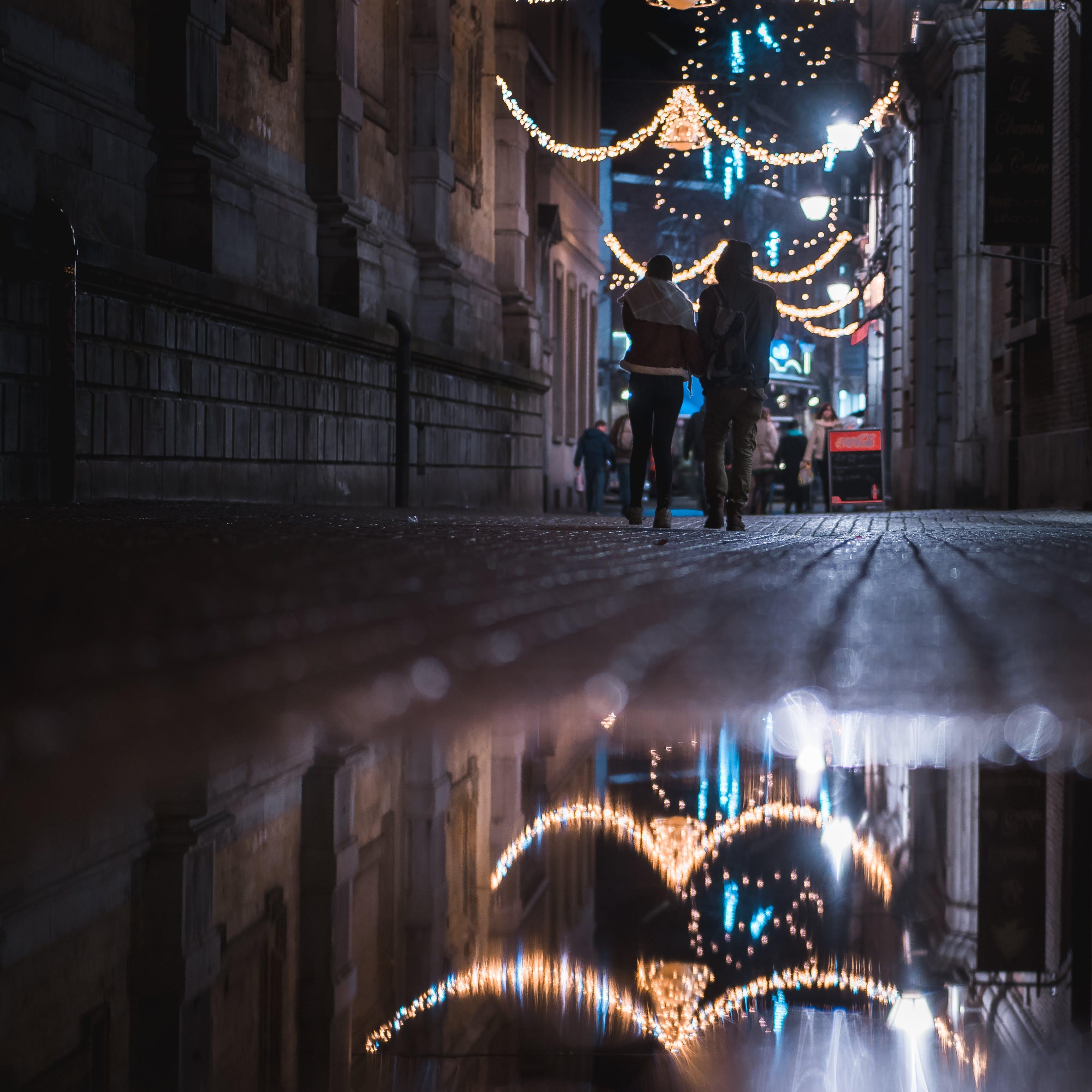 Two Person Walking on Street Corner