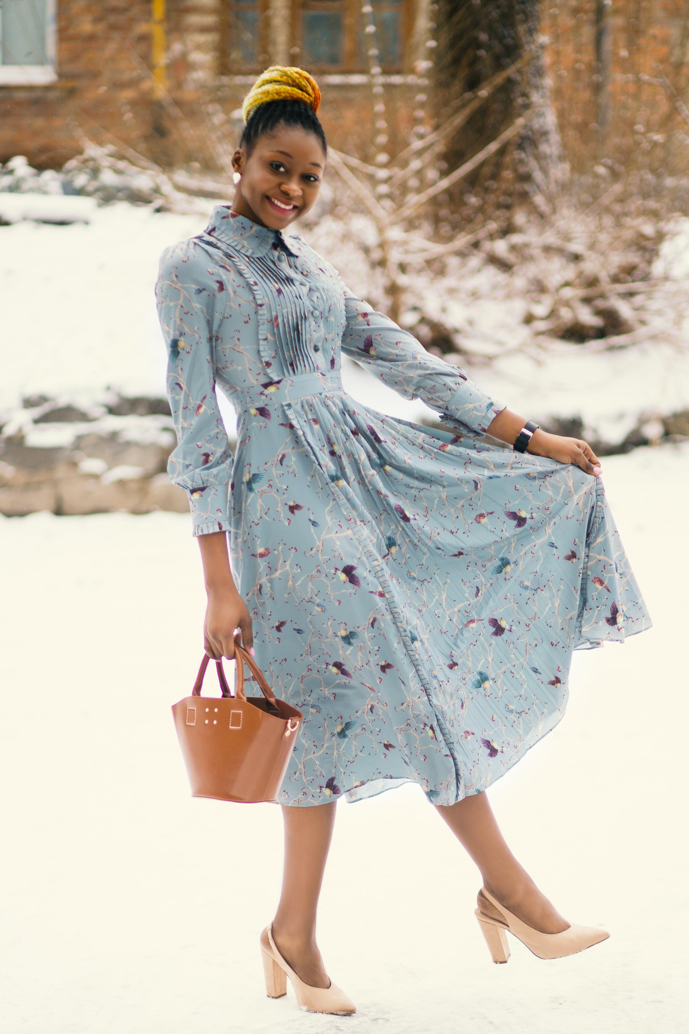 Photo of Woman Wearing Blue Long-sleeved Dress