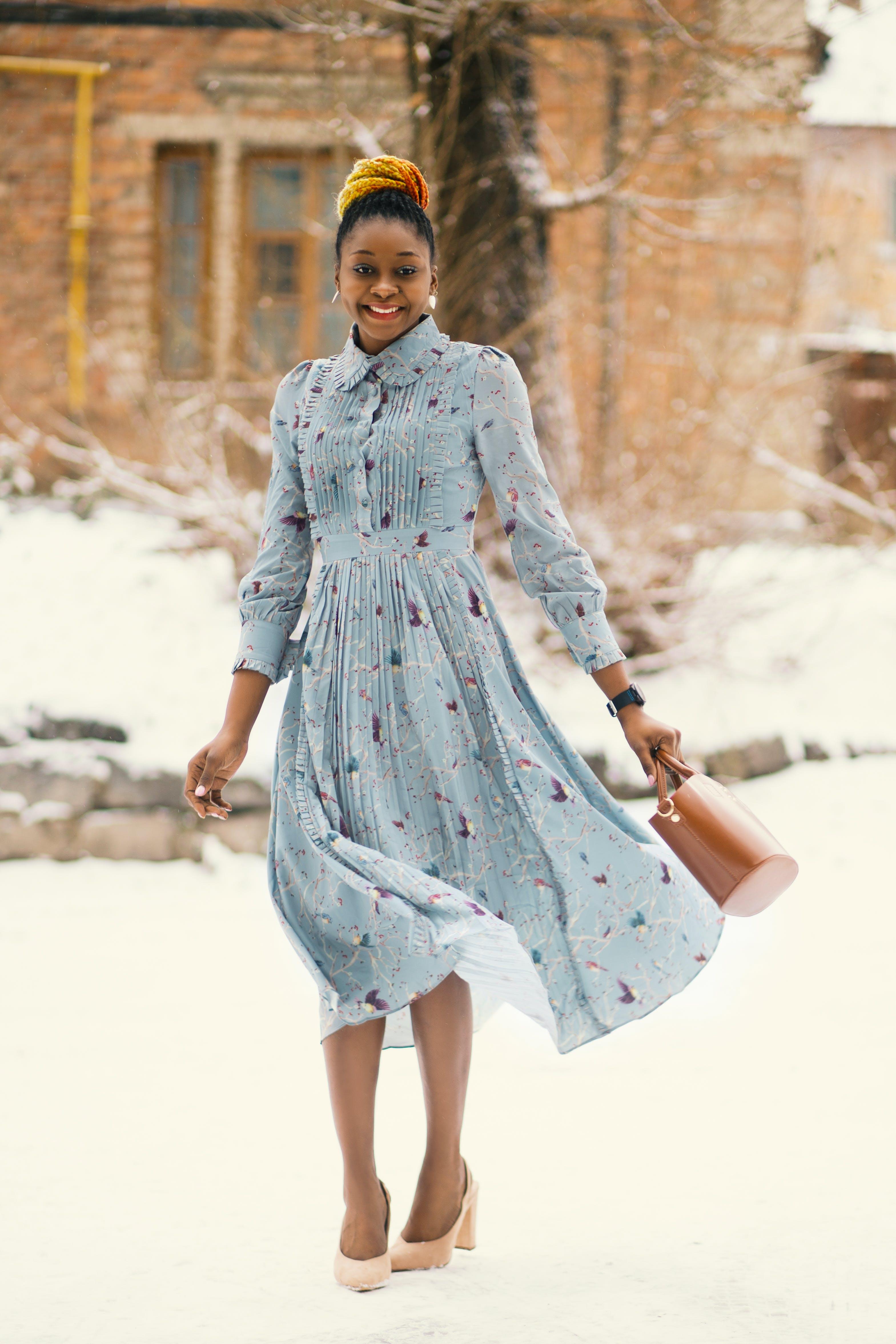 Woman In Blue Long-sleeved Dress