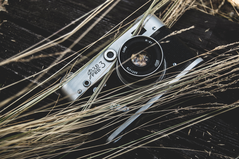 Gray Digital Camera on Brown Surface