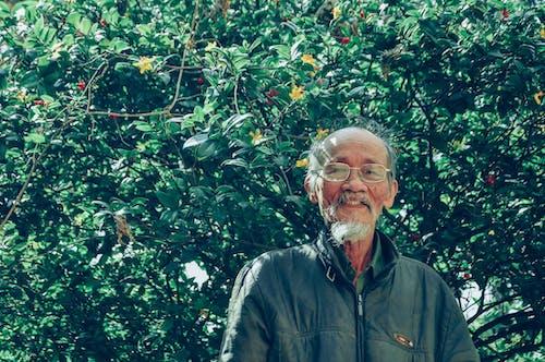 Man Near Leafy Plant