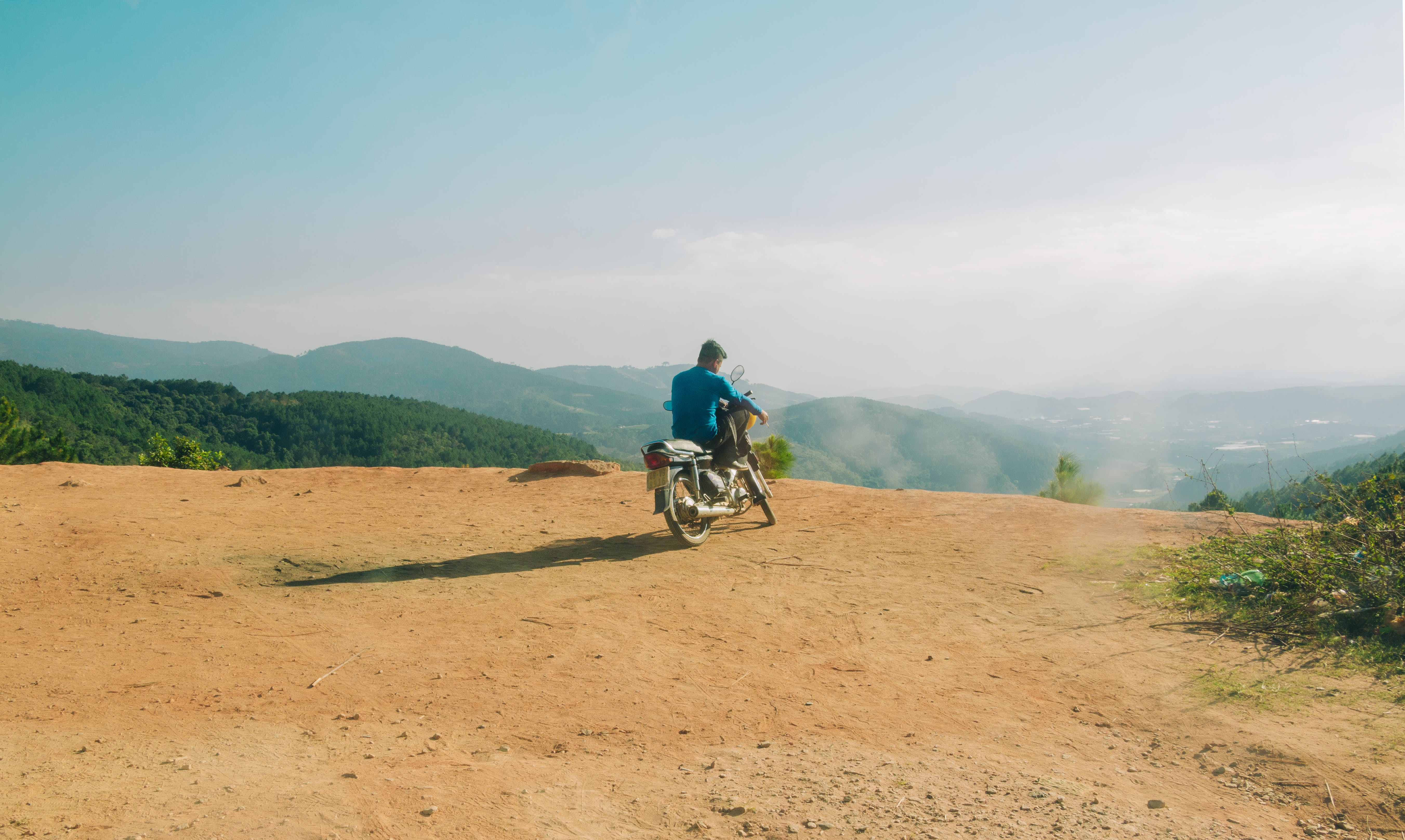 Man in Blue Top Riding Motorcycle