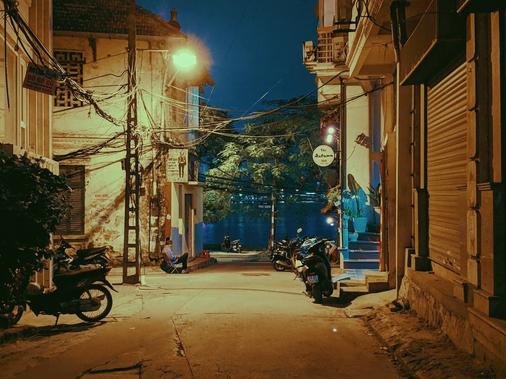 Motorcycles Parked Beside Buildings at Night
