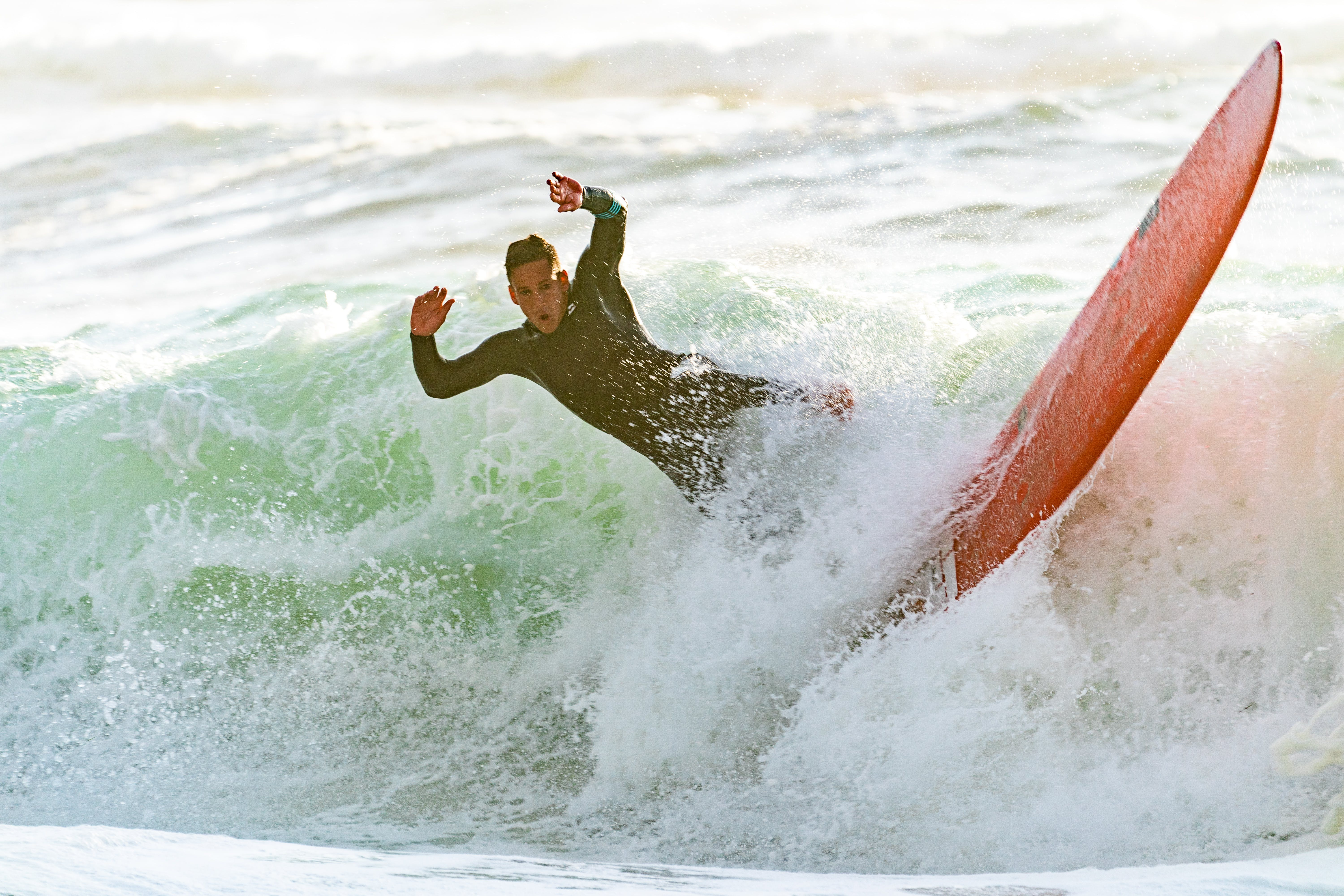 Man Riding a Wave on a Surfboard
