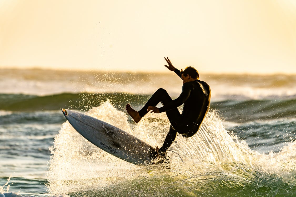 Man About to Wipeout of his Surfboard