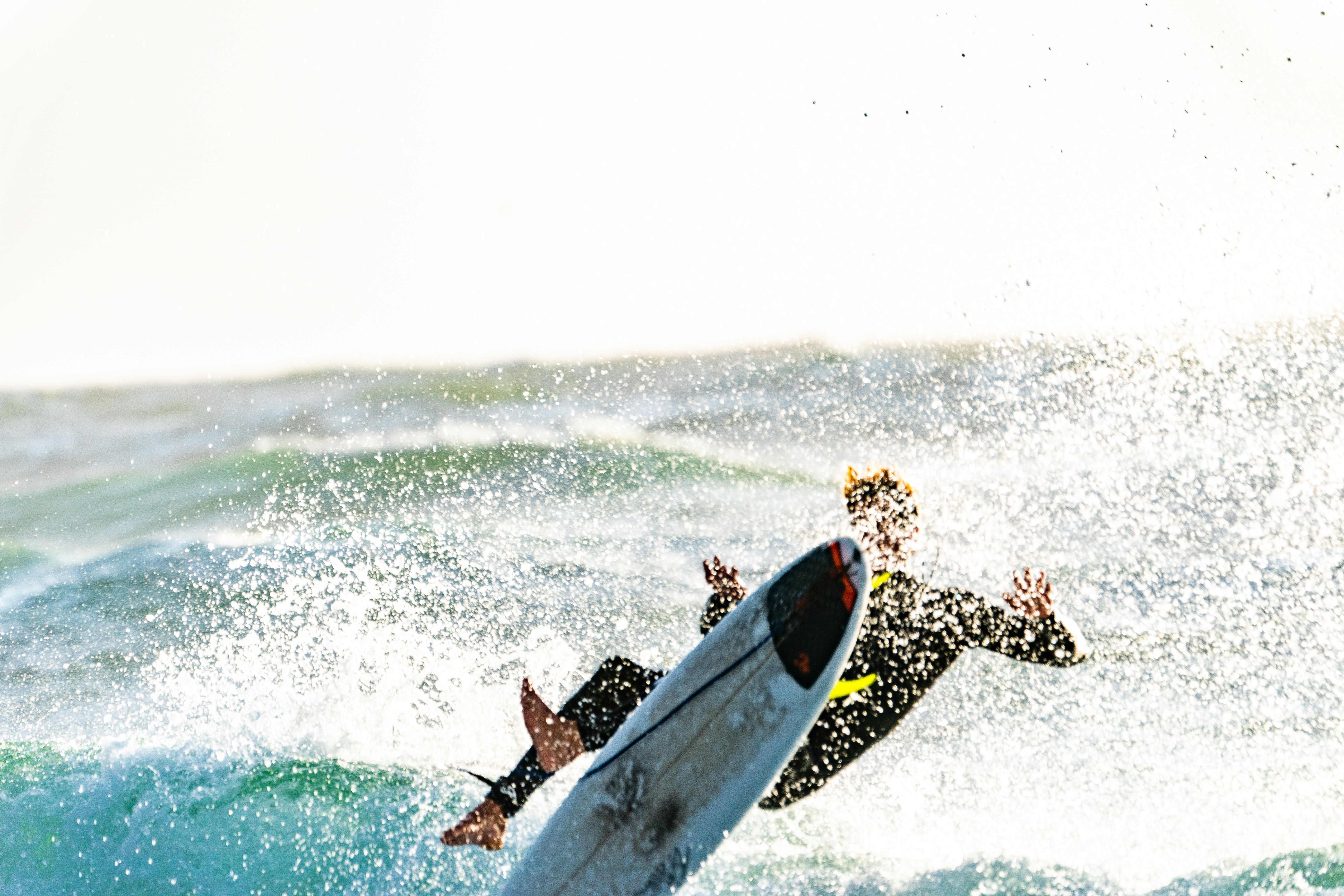 Surfer Wiping Out of his Surfboard