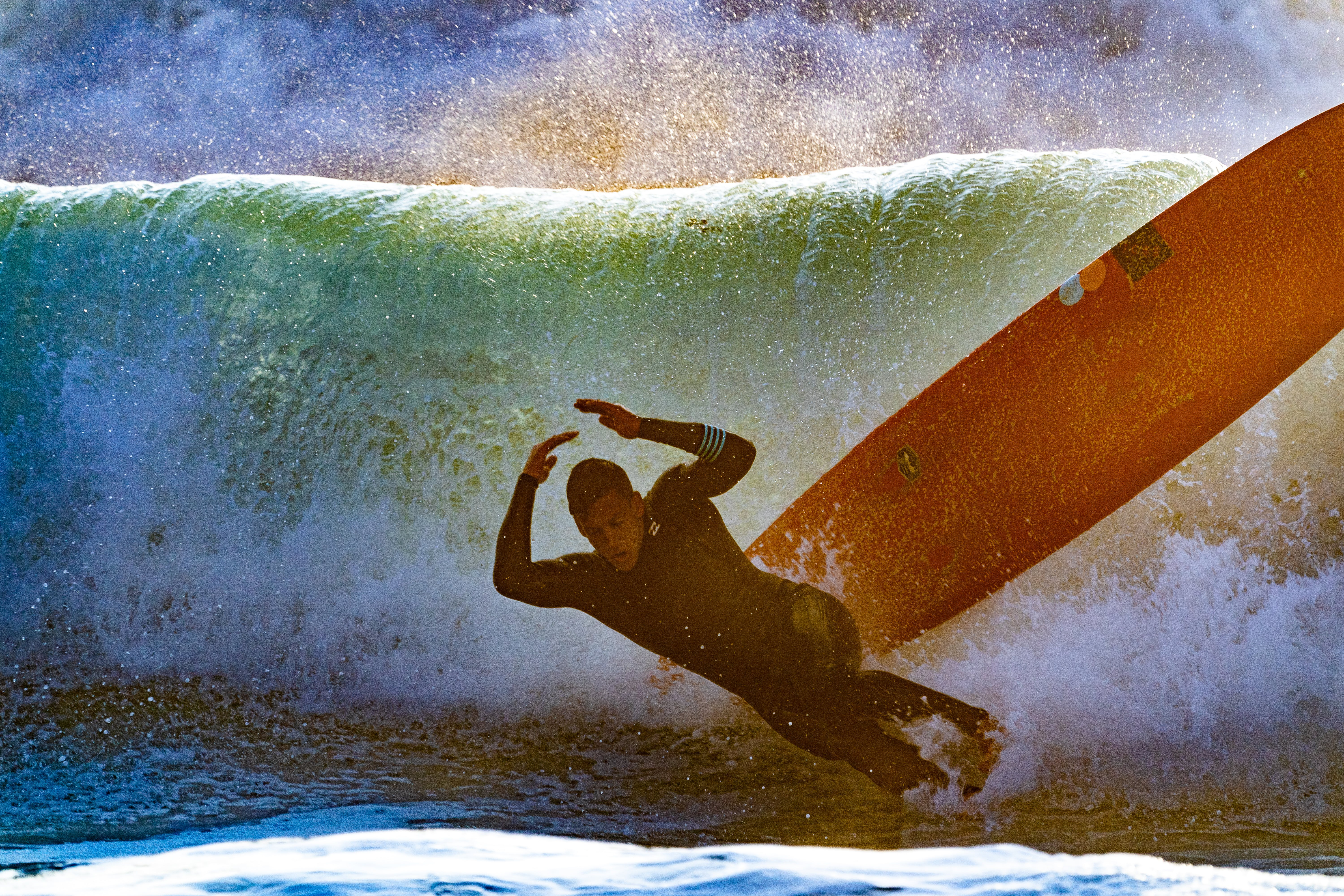 Man Wiping Out of Surfboard